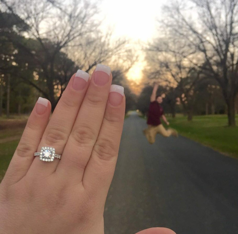 Jodie and Jason's fist pump engagement announcement.