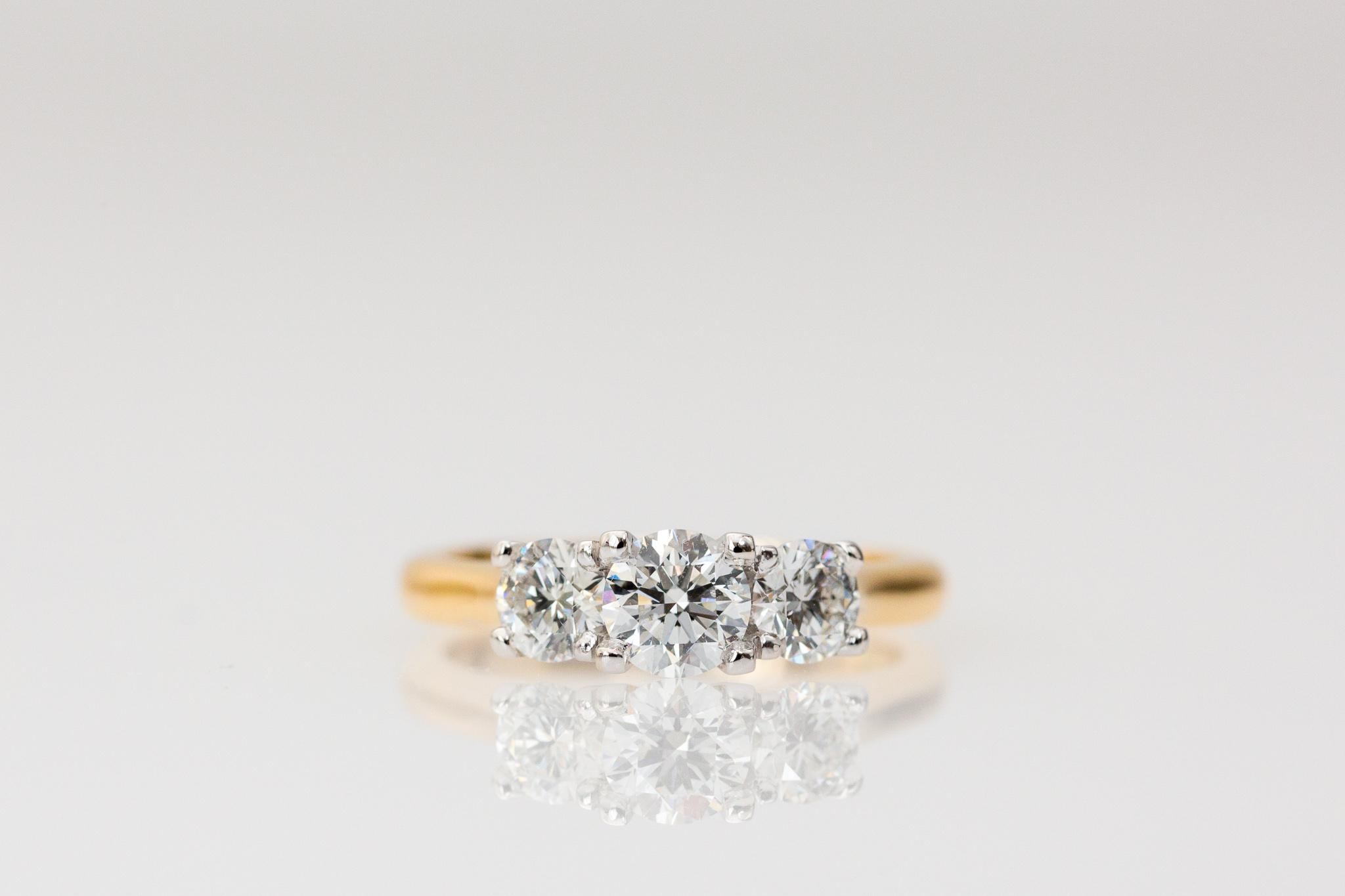 Yellow gold three stone engagement ring.