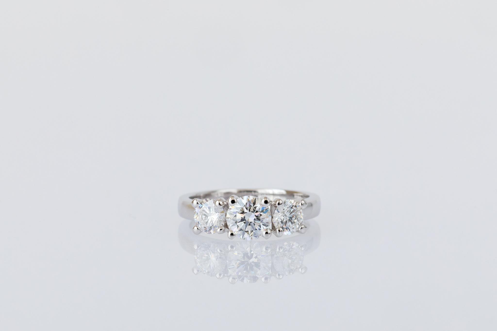 White gold three stone engagement ring.