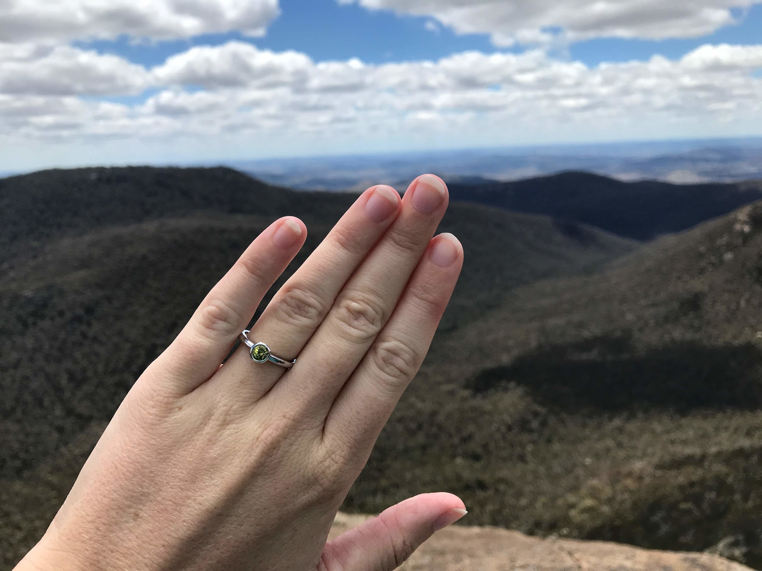Beth wearing her unique engagement ring at Brendan's beautiful proposal location, Booroombah Rocks.