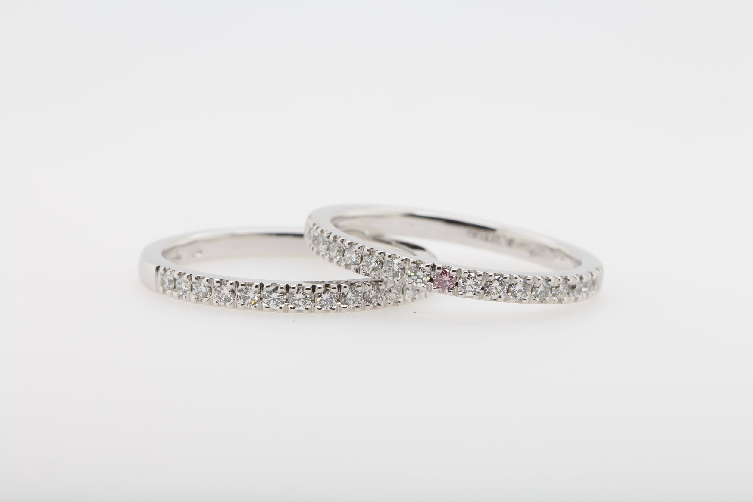 Renee's wedding and eternity ring features a beautiful pink diamond in her eternity ring, to distinguish the two matching pieces.
