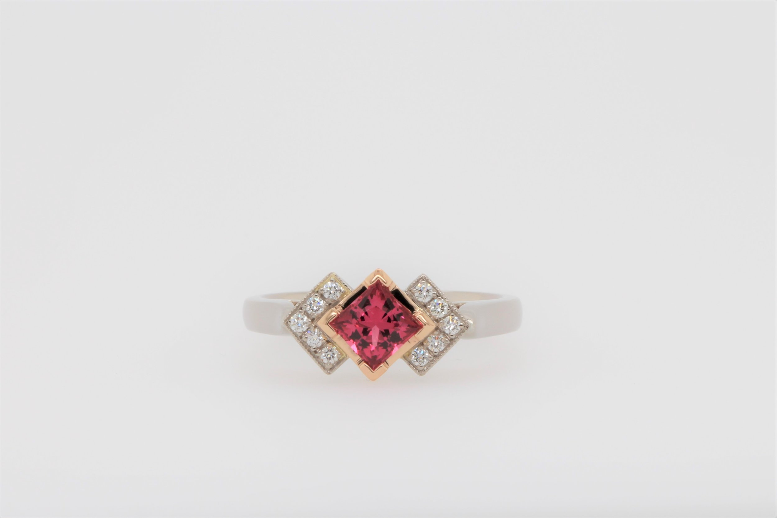 A beautiful bespoke Pink Spinel makes an elegant statement in Jess's right hand ring.