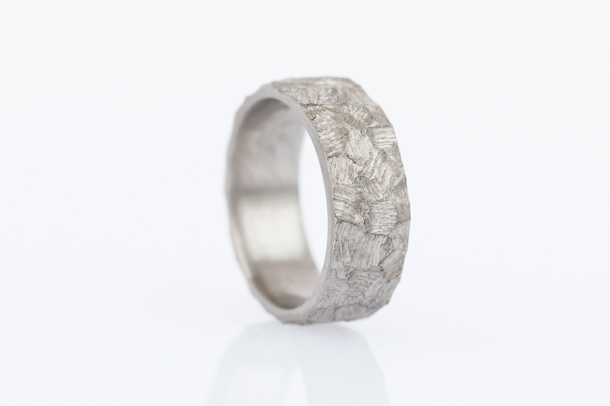 Igor's custom textured wedding band makes a unique statement.