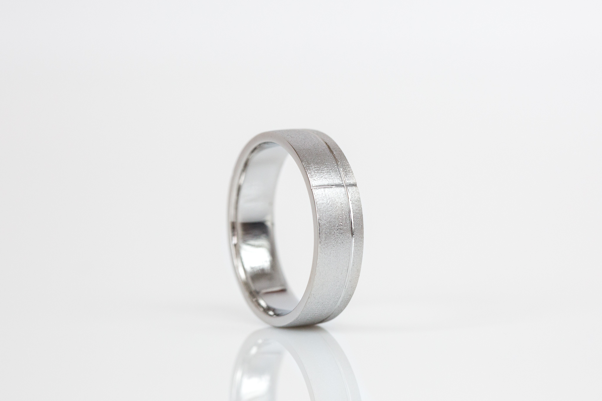 Anthony's matte wedding ring features polished line detailing.