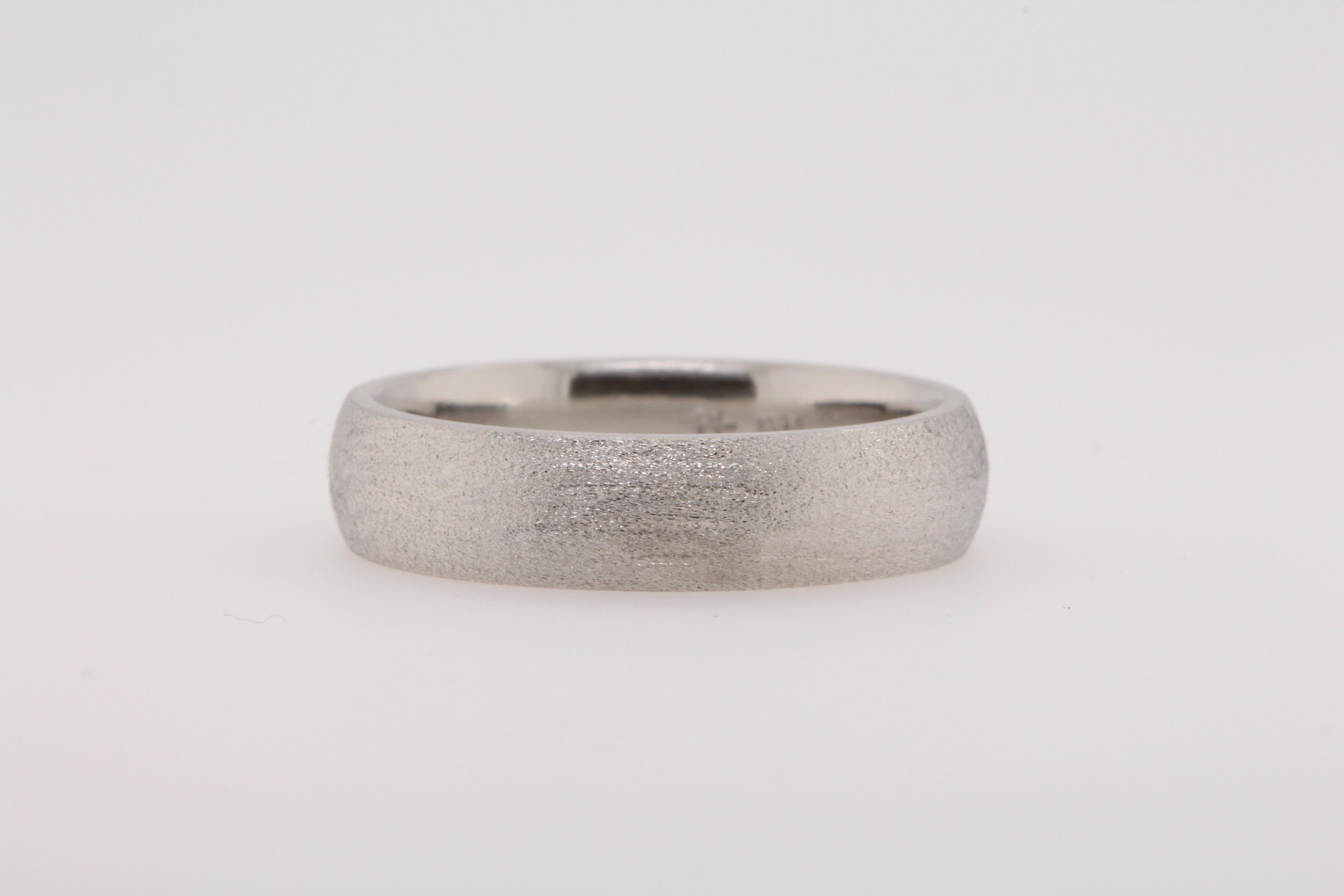 Brad's brushed wedding band is practical to wear.