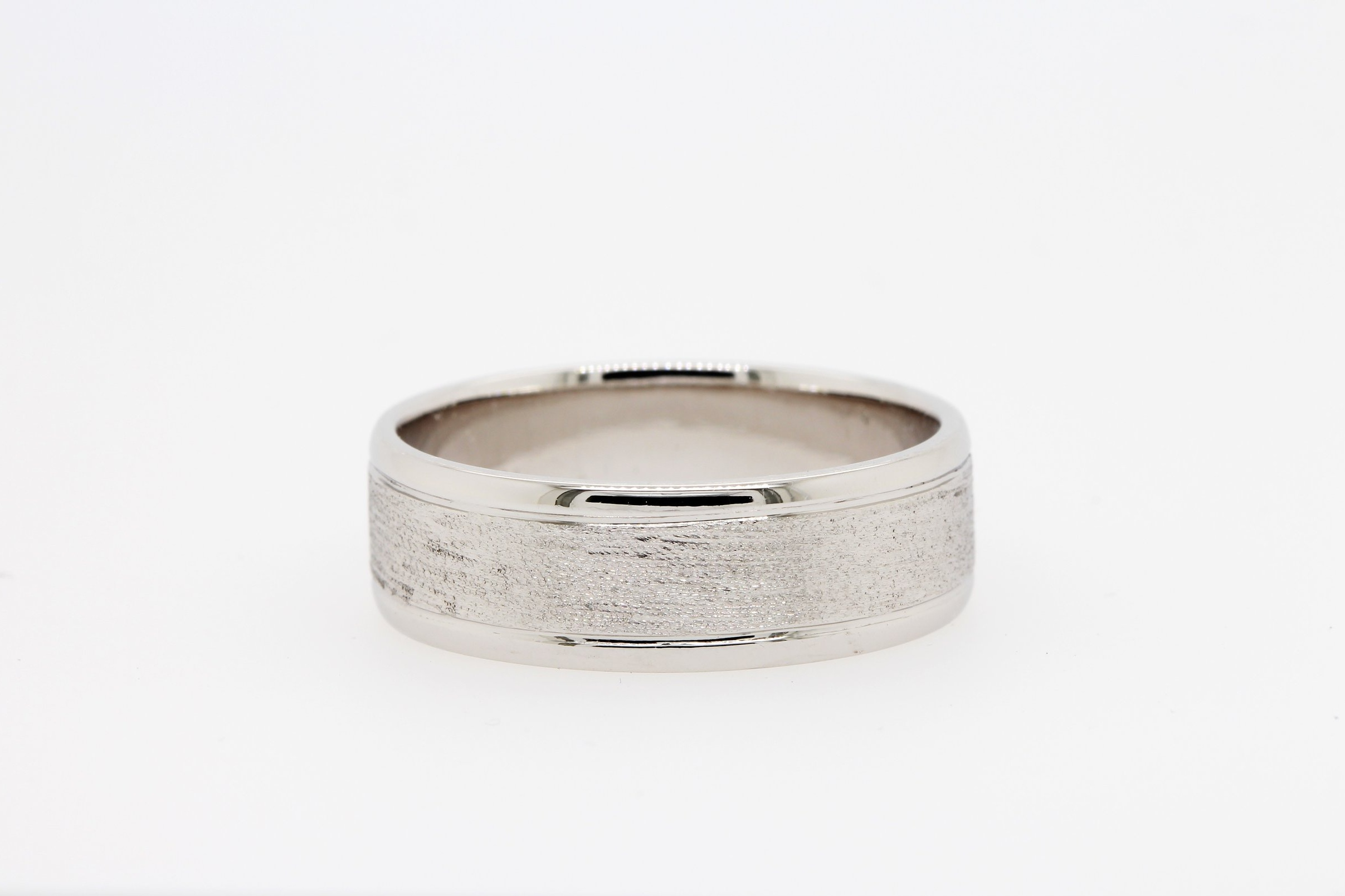 Mitch's wedding ring combines both polished and brushed textures.
