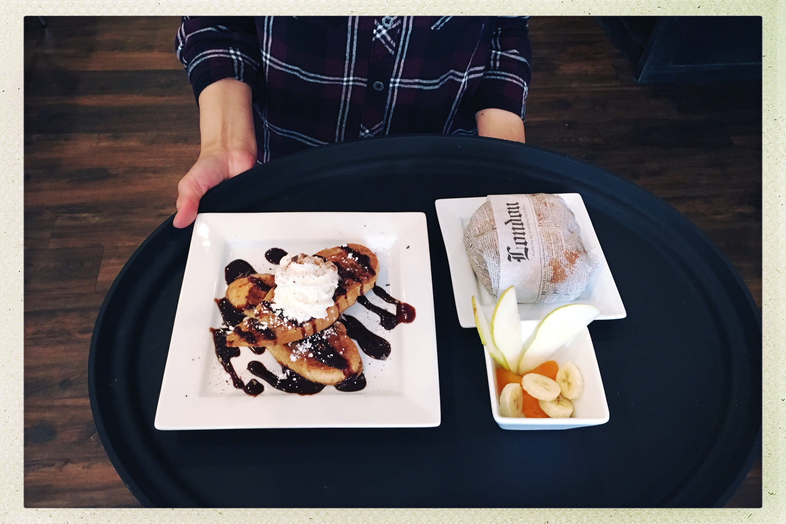 Chocolate Hazelnut French Toast, Crossiant Breakfast Sandwich and cup of fruit