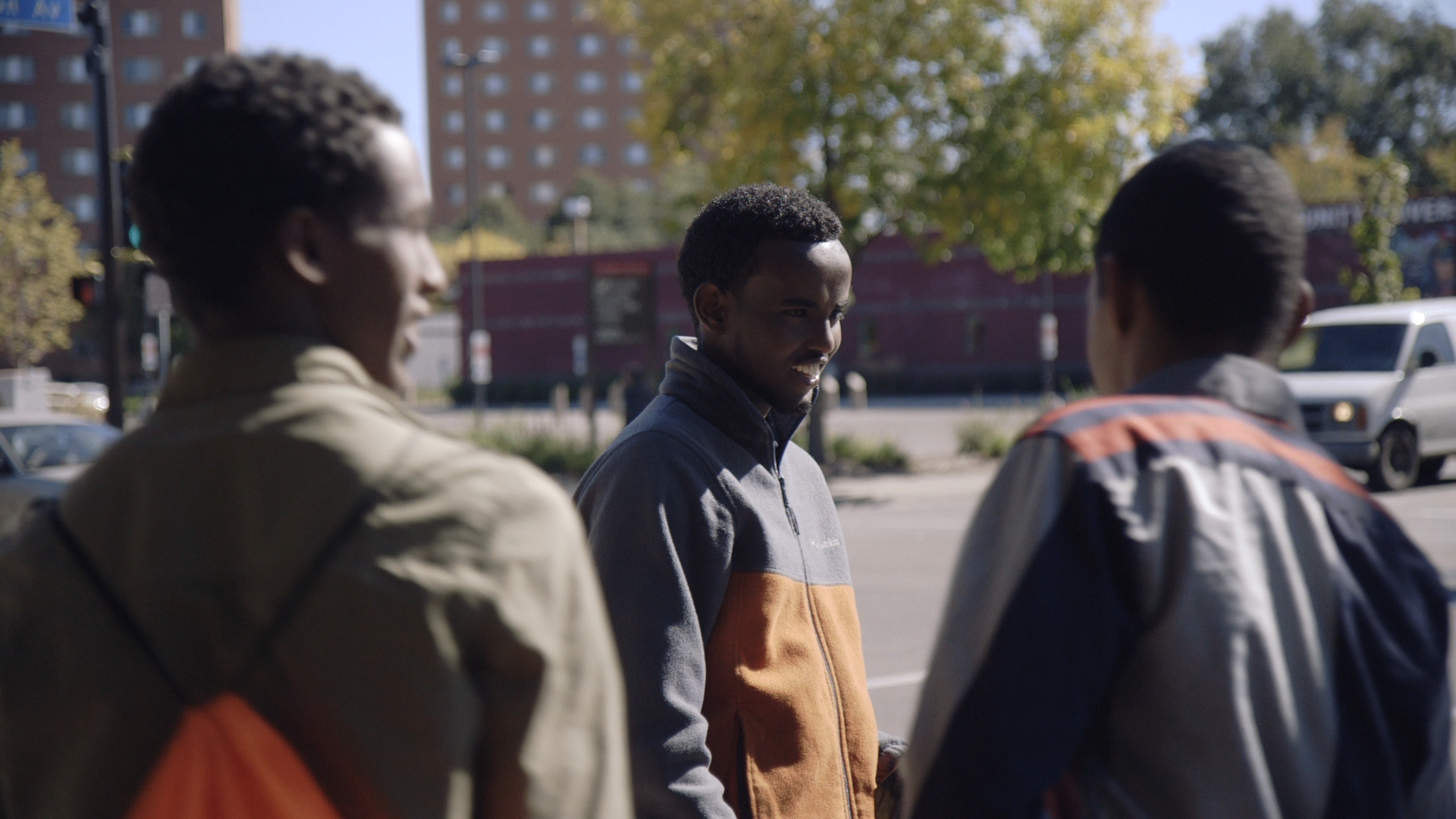 """Minneapolis Parks Commissioner A.K. Hassan talks with youth in """"Work of Windlike."""""""