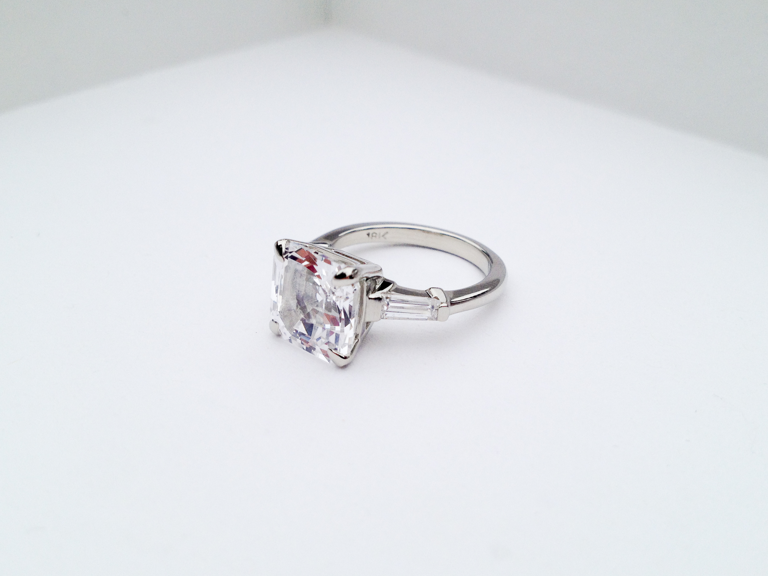 ADELE Engagement Ring:  ethically-sourced, lab-created, asscher-cut white sapphire, baguette diamonds, 18k white gold.