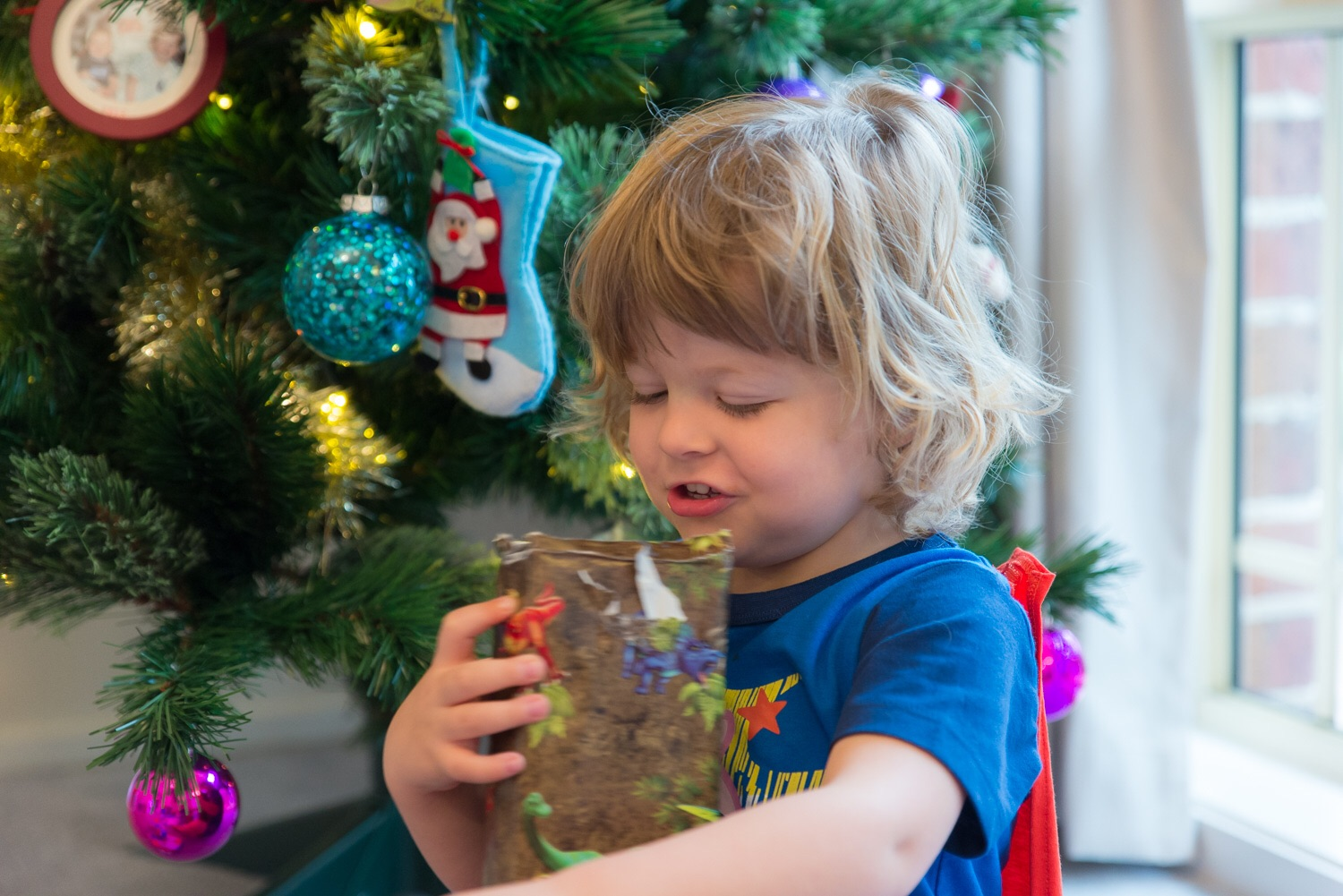 Opening presents...I think big brother was almost more excited than him so this is a rare photo where he's opening it by himself!