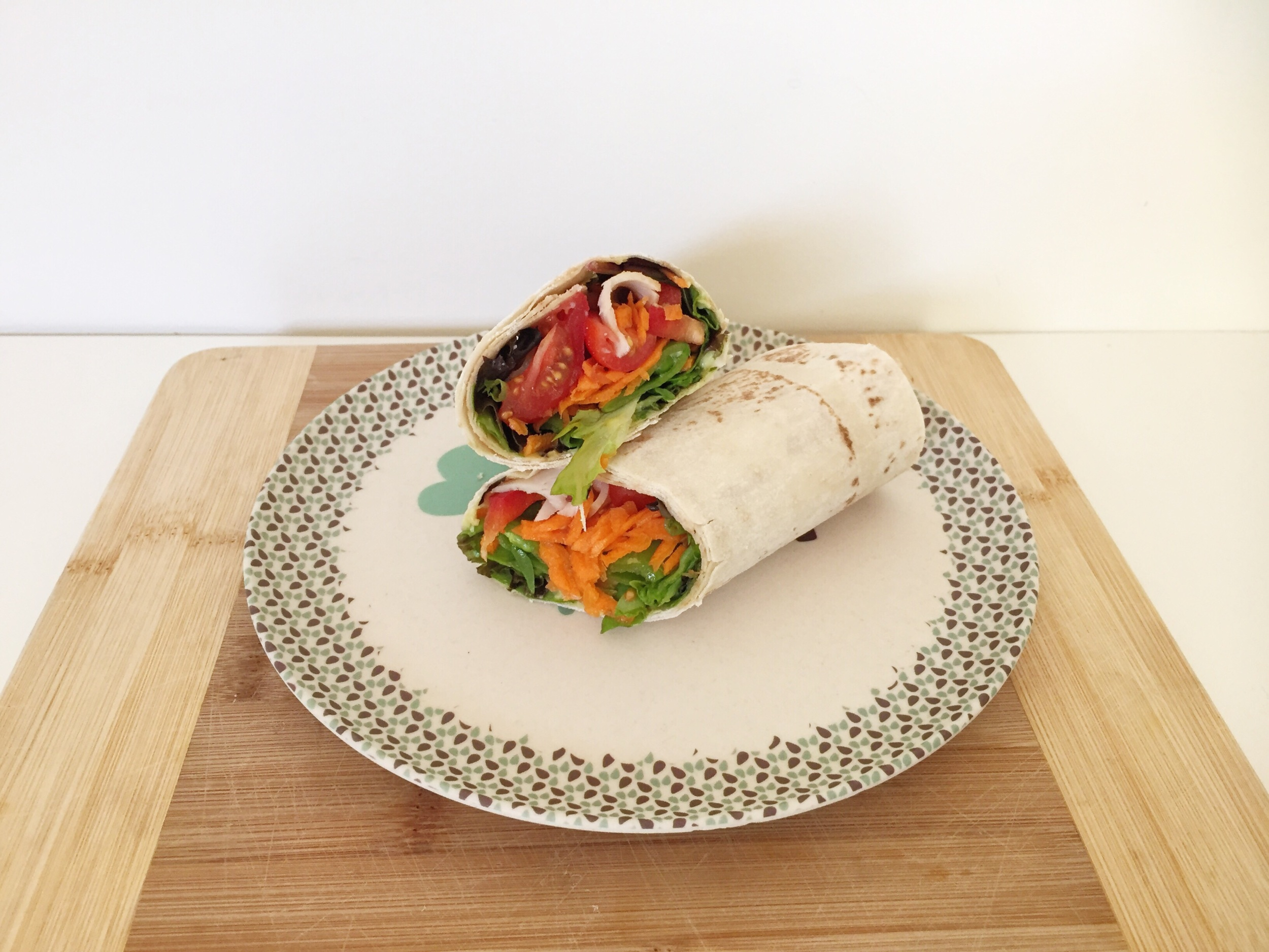 Lunch: mountain bread wrap with green salad, tomato, carrot, avocado, capsicum and turkey