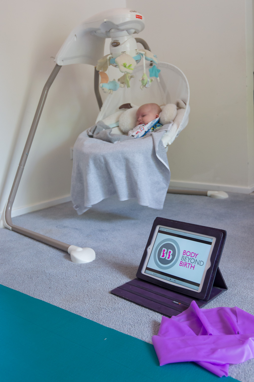 Completing my online workout while Bub slept in his swing