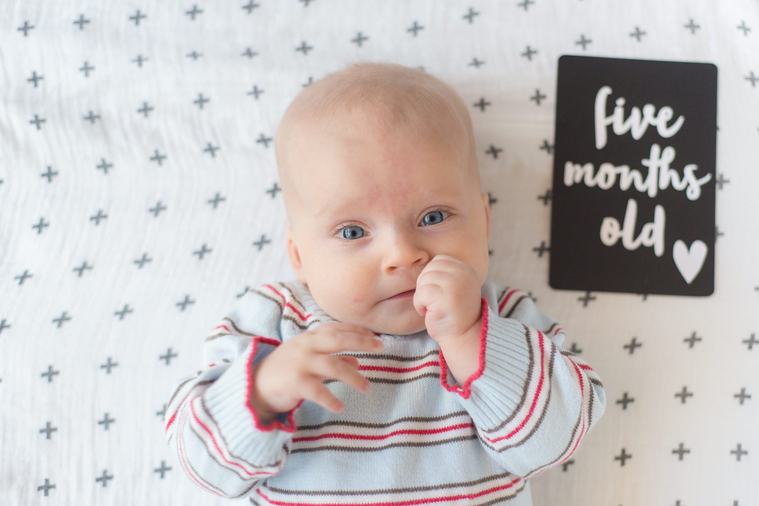 5 months old- munching on those hands