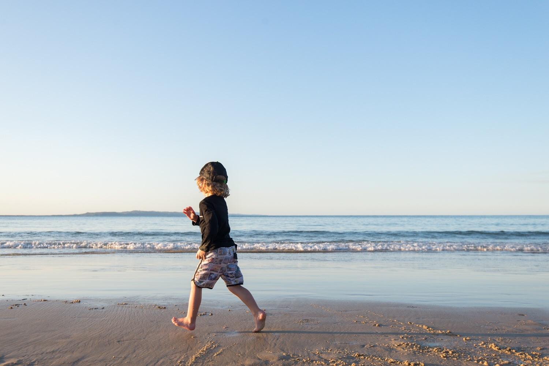 Mr 3 running on Noosa beach