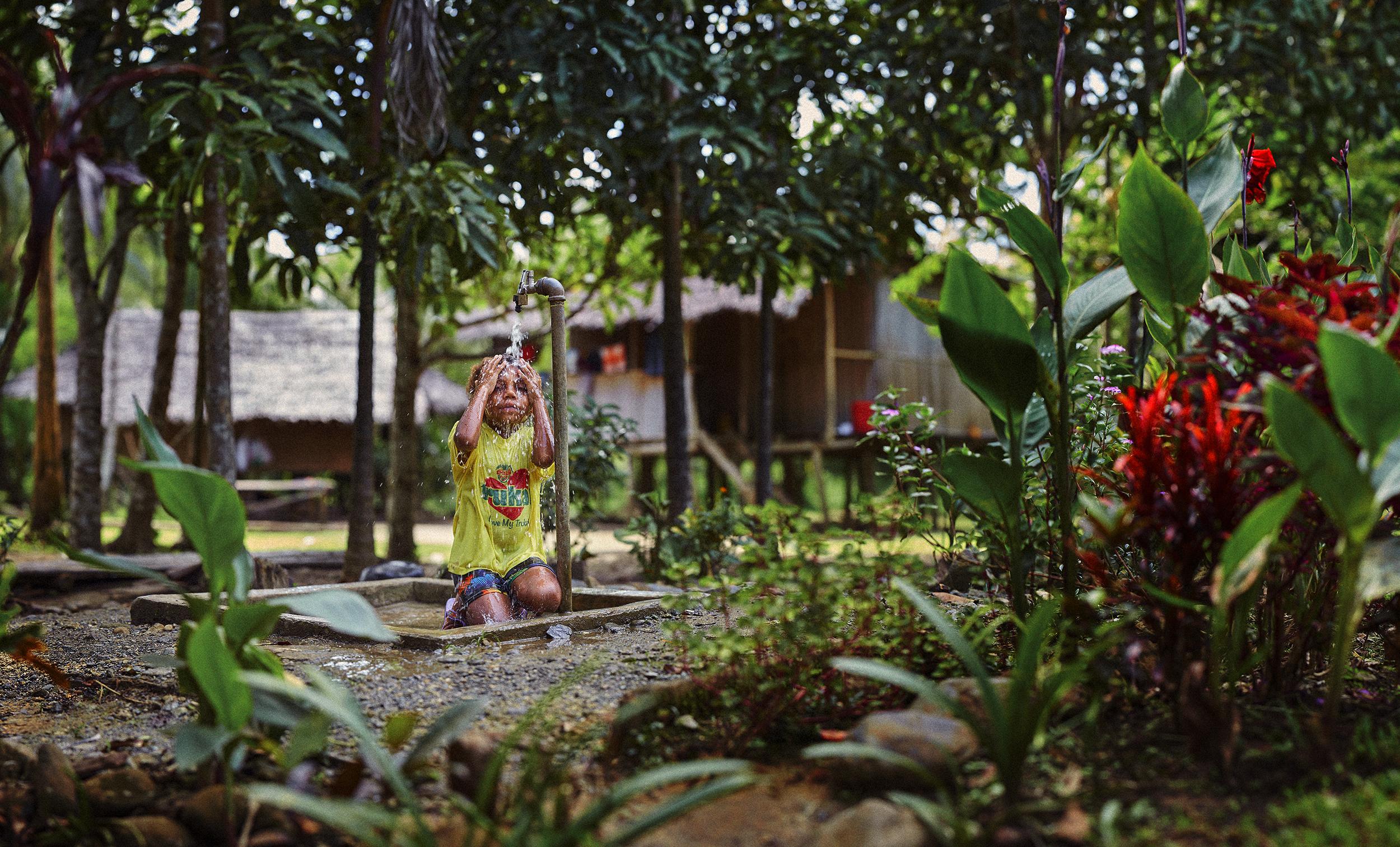 Girl Washing at Tap Panorama 2 copy.jpg