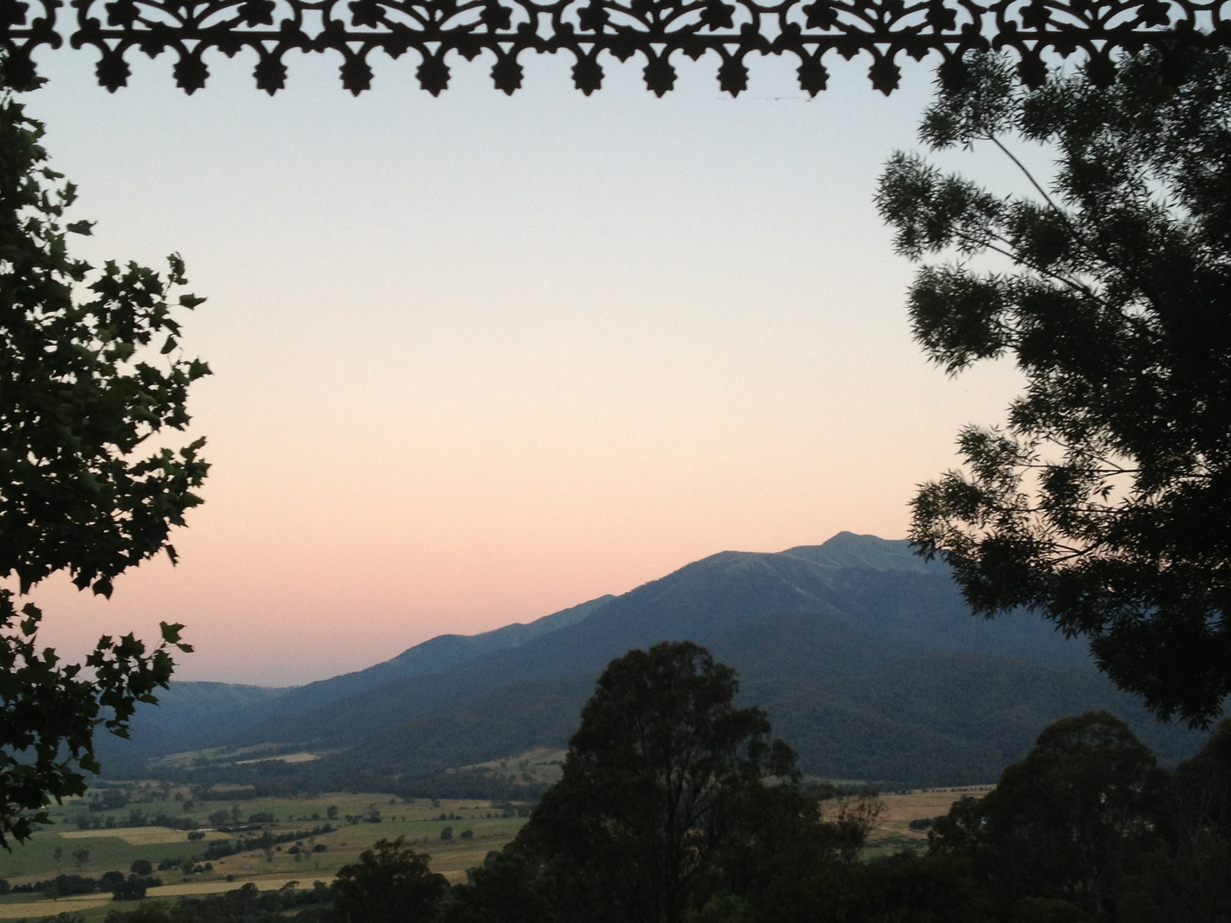 Mid-Summer view to Mt Bogong, Victoria's highest mountain from the Lodge. With Mt Beauty township well below.