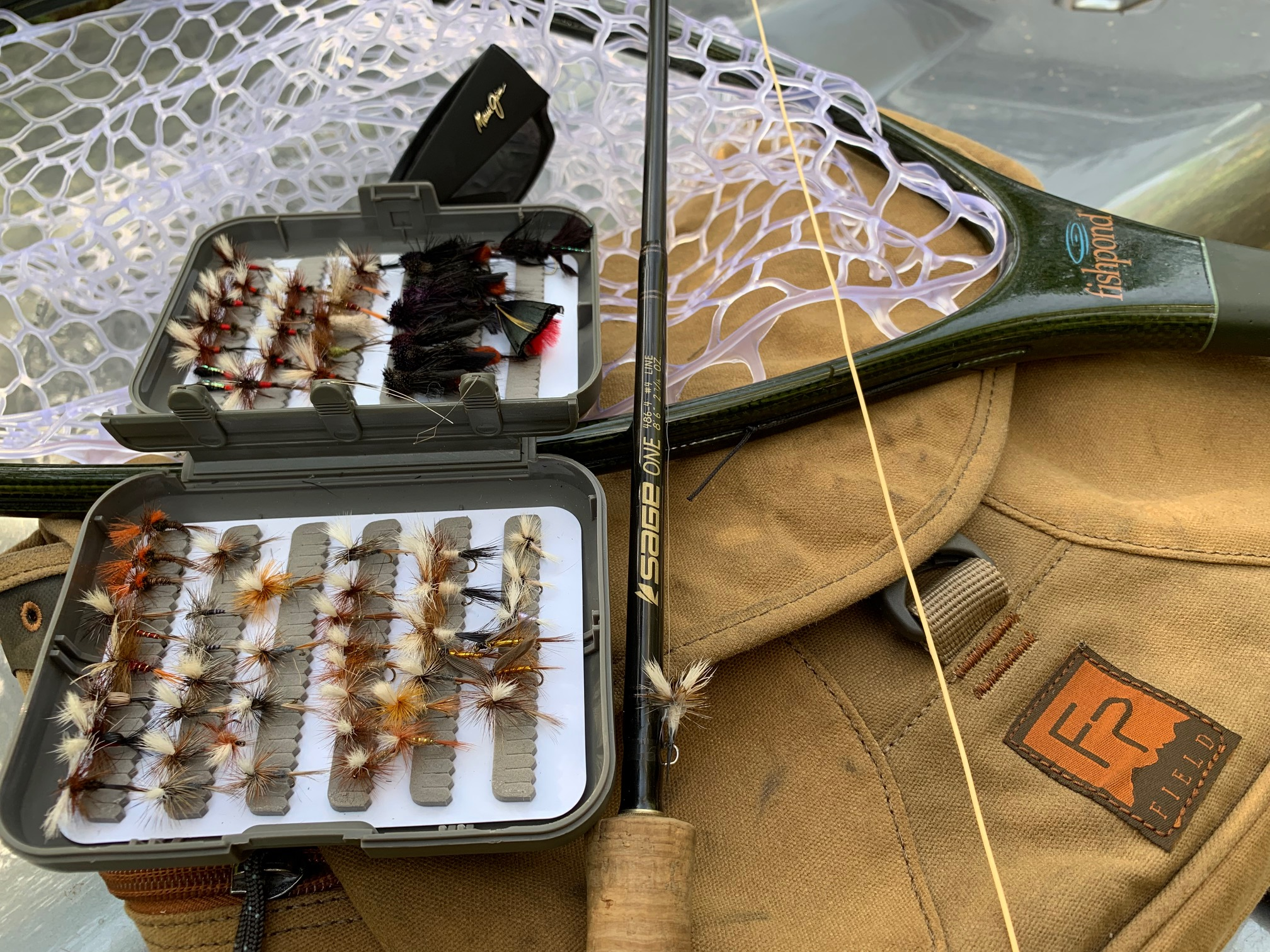 Checking the 'kit' prior to walking down to another of our local wilderness trout streams. The Summertime dry fly fishing is terrific!