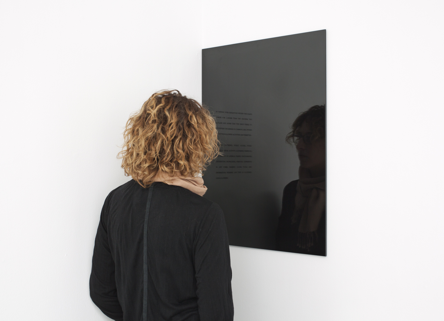 Carey Young, 2010, Obsidian Contract,  vinyl text and black mirror. First exhibited at Paula Cooper Gallery, New York