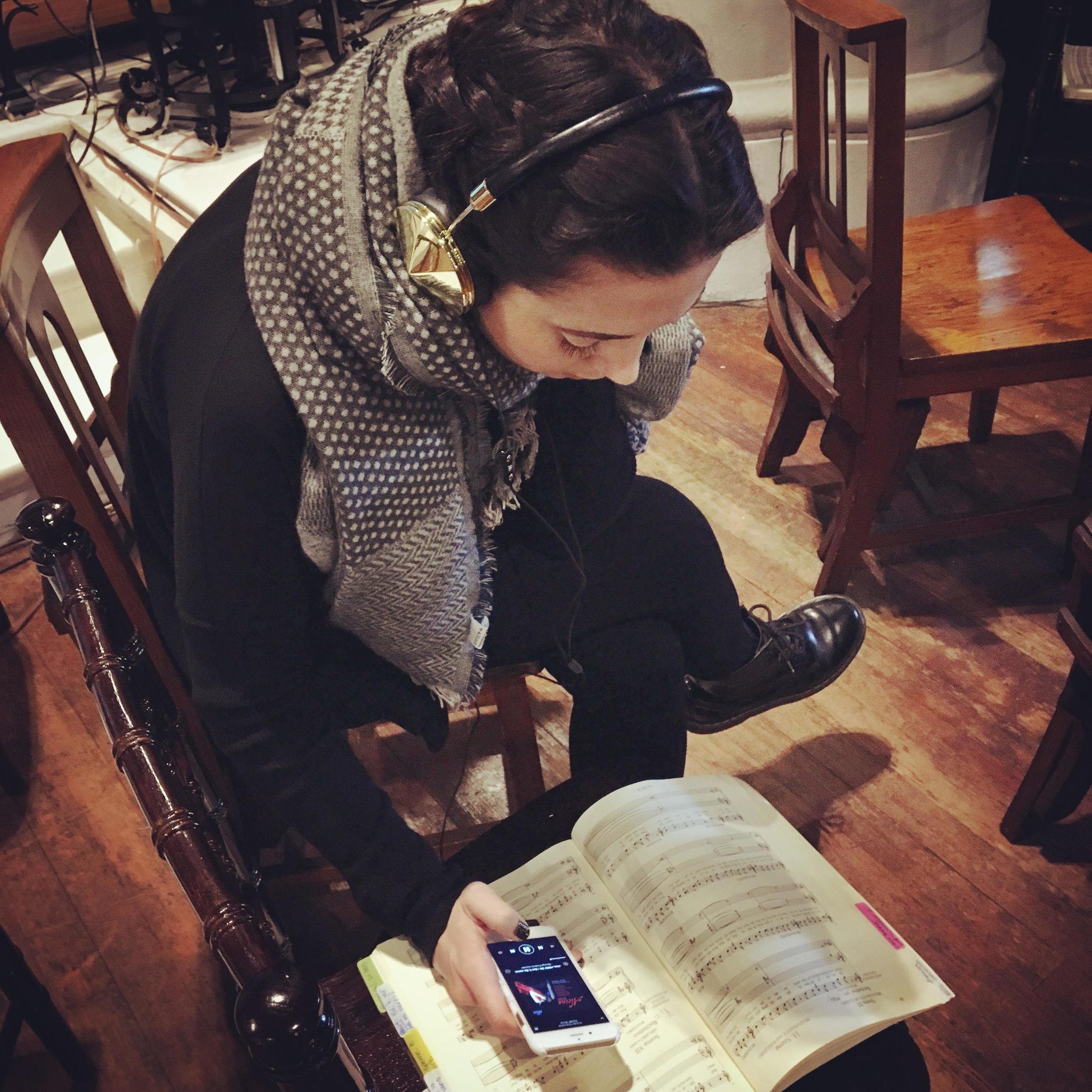 Barbara studies her music in between rehearsing scenes.