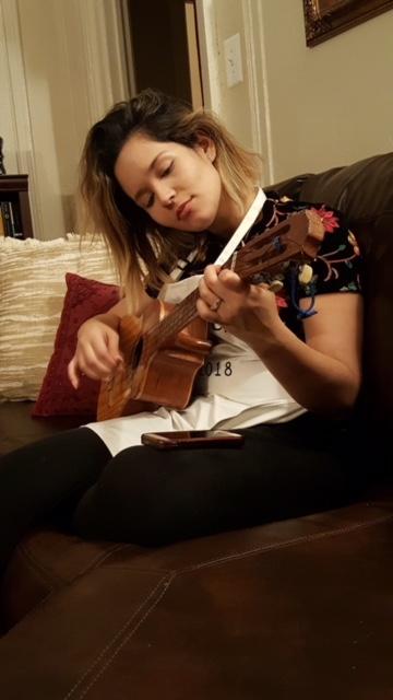Playing the cuatro ( Venezuelan traditional instrument)