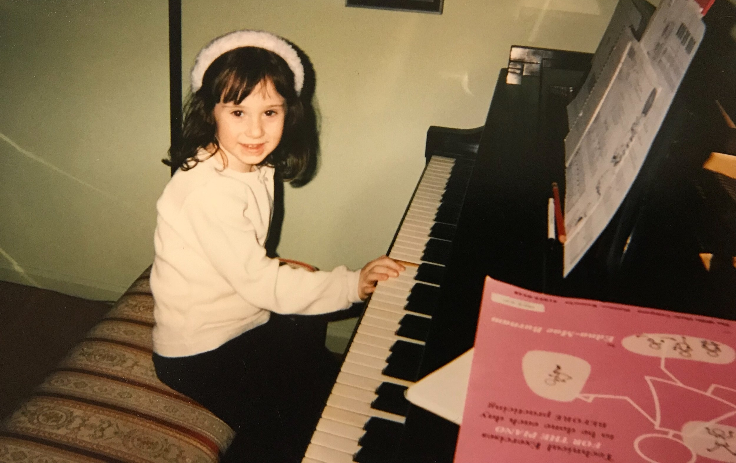 At a piano lesson with her great aunt.
