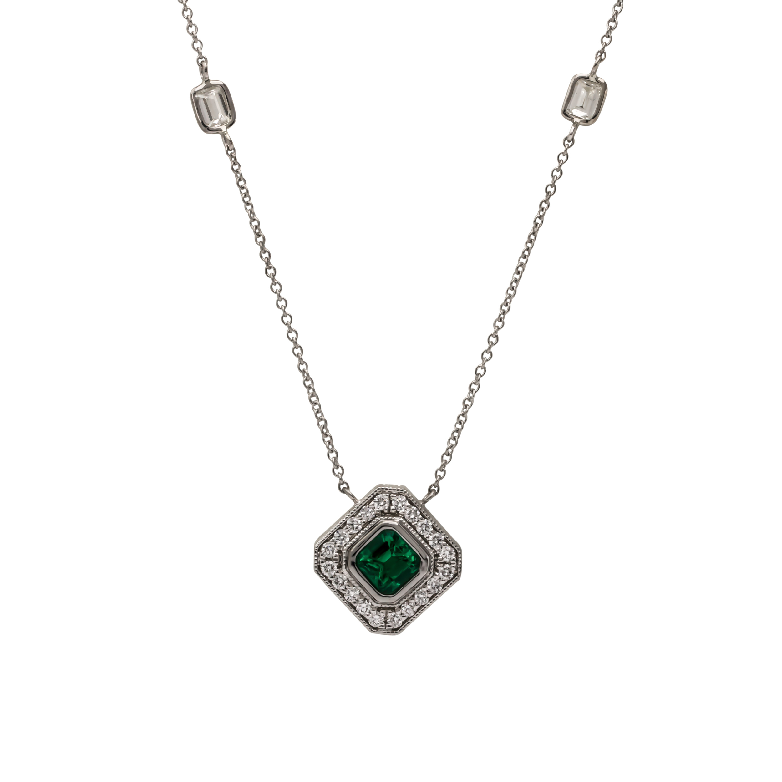 CUSTOM EMERALD AND DIAMOND PENDANT designed using the stones from our client's ring.