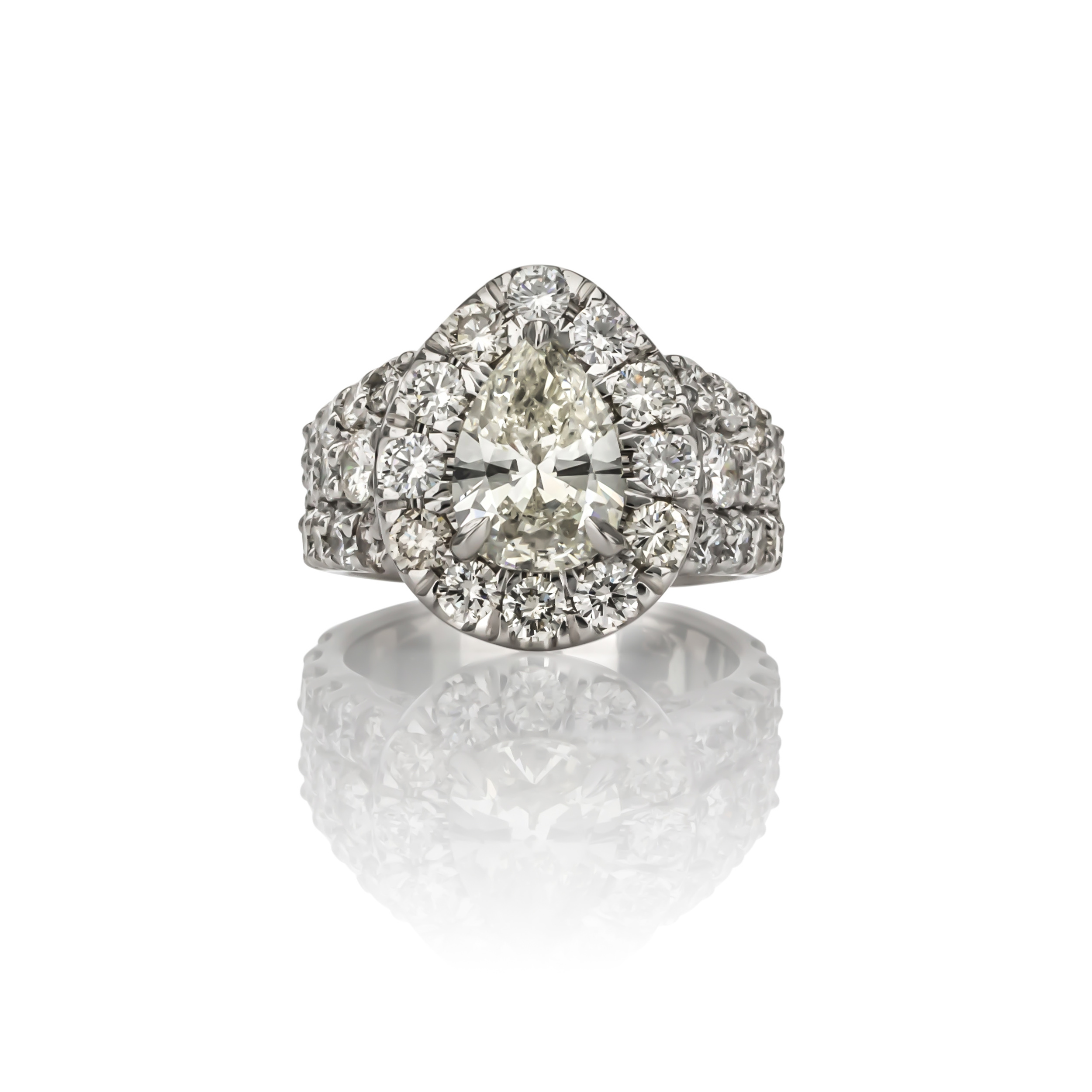 CUSTOM DIAMOND RING designed using our client's original pear shaped diamond.