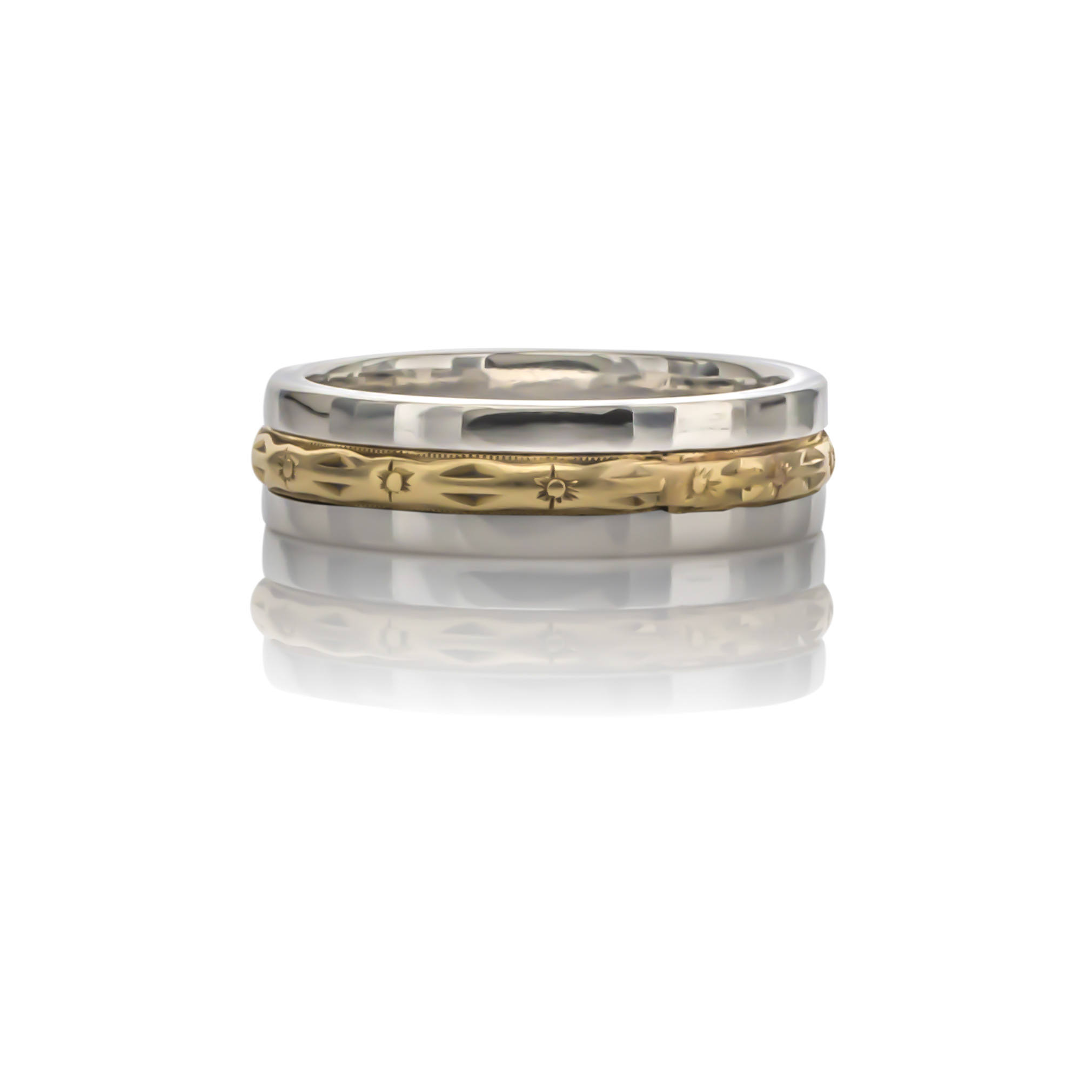 CUSTOM TWO-TONE MENS WEDDING BAND designed  this modern men's platinum wedding band to feature our client's grandfather's 14K yellow band as an inlay.