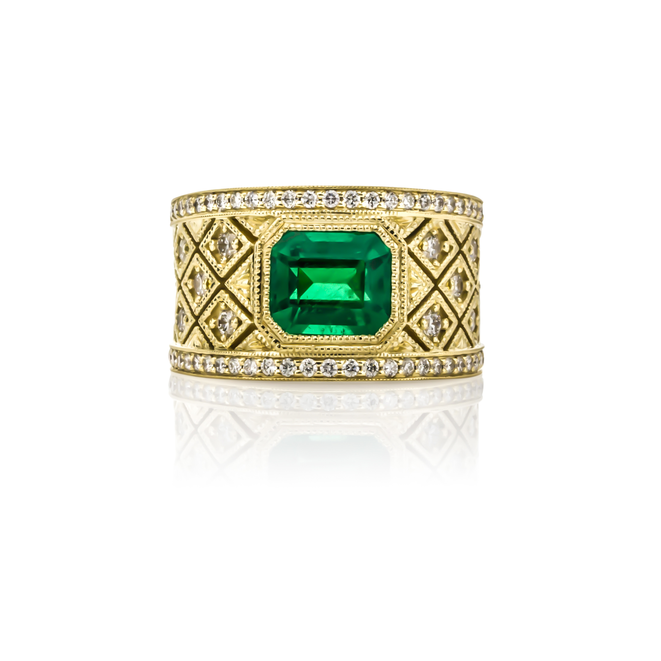 CUSTOM EMERALD AND DIAMOND RING SET IN 18K YELLOW GOLD WITH HAND-ENGRAVED DETAIL