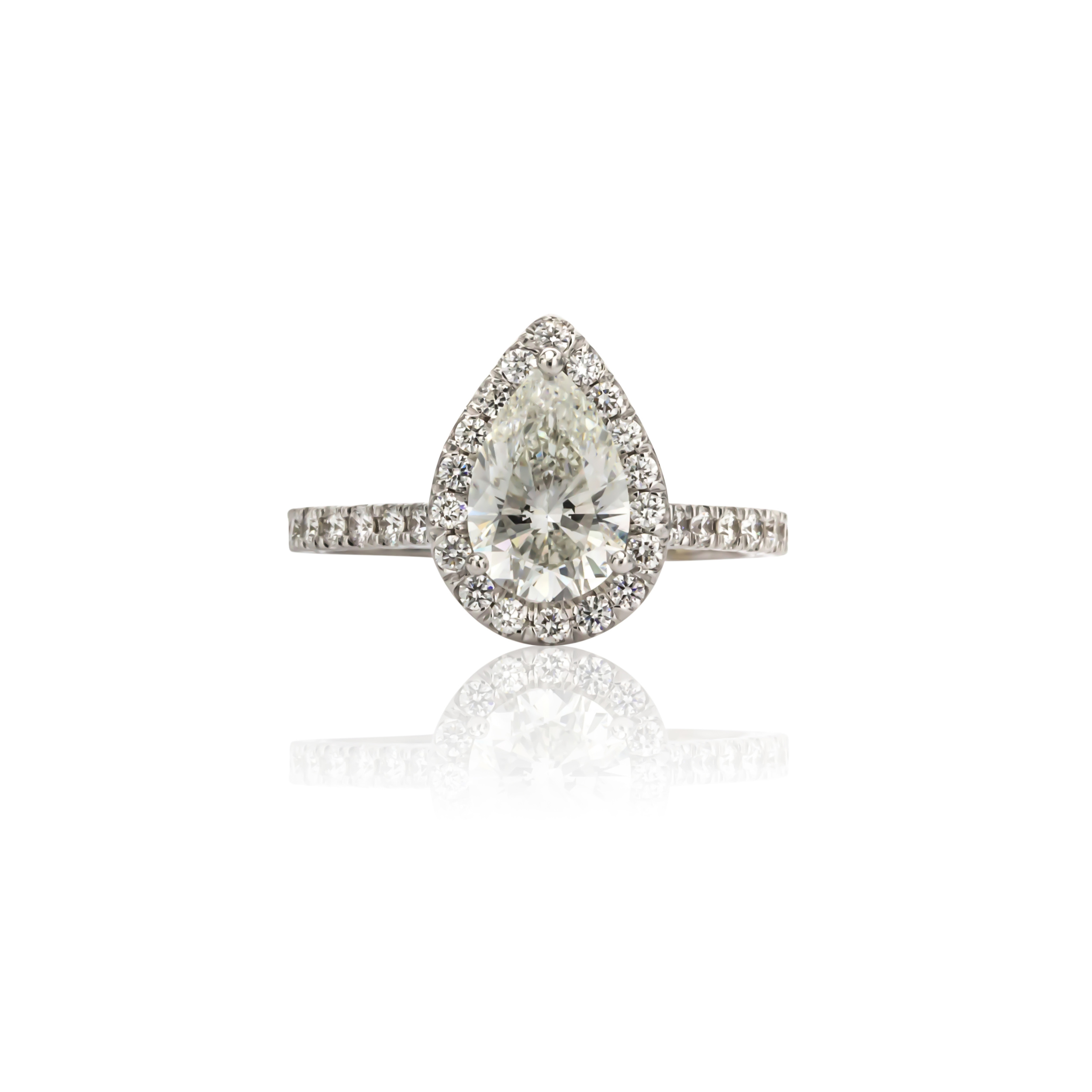 CUSTOM PEAR SHAPED DIAMOND HALO ENGAGEMENT RING