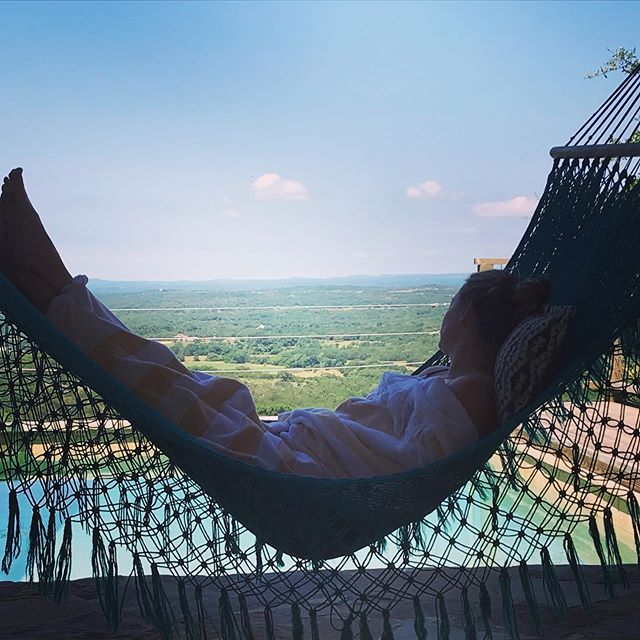 Ah, now that's a good morning. @lorinmlopez relaxing by the pool in a hammock overlooking that spectacular view.