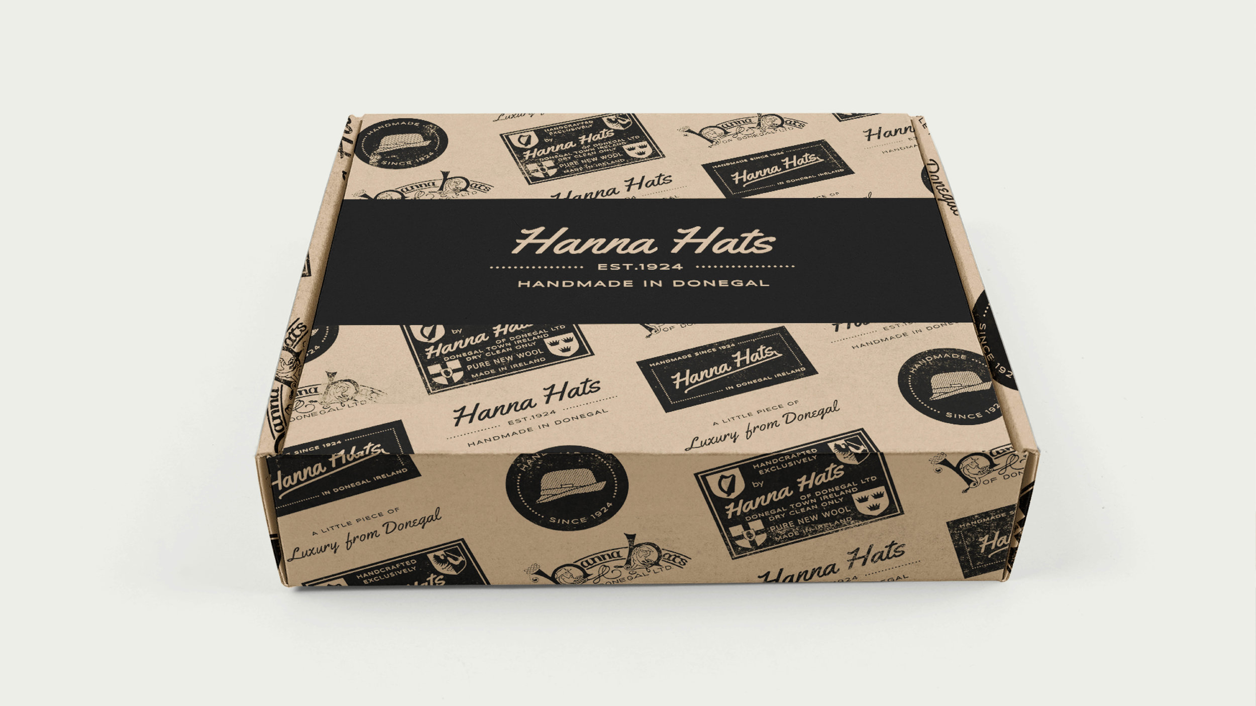 The third option is incorporating the retro logos charting the history of the brand printed in black onto the box. We really love this one too, it's unique and personalised to Hanna Hats and would make a stylish choice.