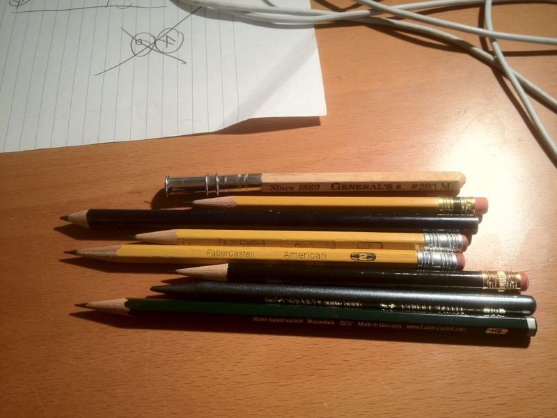 I use the pencil extender (top) when said pencils get too small to hold easily.