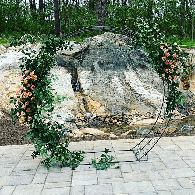 I love the use of this Circle arch with the flowers as part of the backdrop for a wedding. What are you using for your wedding? We got married at my church so we just had the alter flower. #askinstagram #circlearch #wedding #southerncharmplanning #weddingbackdrop #ceremony #florals #rosemontmanor