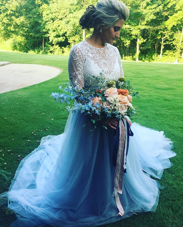 When looking for that perfect dress, would you consider having color in the dress? How about using a top and a skirt? This here is an example of both! If you would use a color, which color would you consider? 💐@maryannblooms  hair & makeup @radiantreflection_muah  bridal top: @yoursandminebridal  skirt @mrprettyskirt  #southerncharmplanning #flowers #bouquet #mrprettyskirt #coloredweddingdress #weddingdress #rvawedding