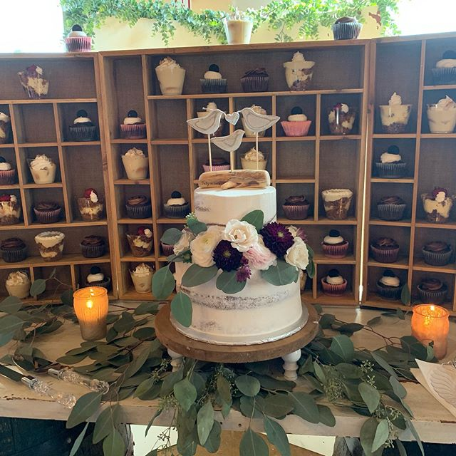 This cake and display is so unique! It goes to show that things that weren't made for a specific purpose can be utilized in different ways. I absolutely LOVE the cake topper to signify Page, Scott, and Page's daughter Cameron! Precious! Cake: @sugar_heads  Display: @boss_bigmamma Flowers: @kwfweddings Venue: @alturiafarmweddings #wedding #cake #cupcakes #keylimepie #bananapudding #strawberrycheesecake #peanutbutter #weddingcake #kwfweddings #weddingtopper #delicious