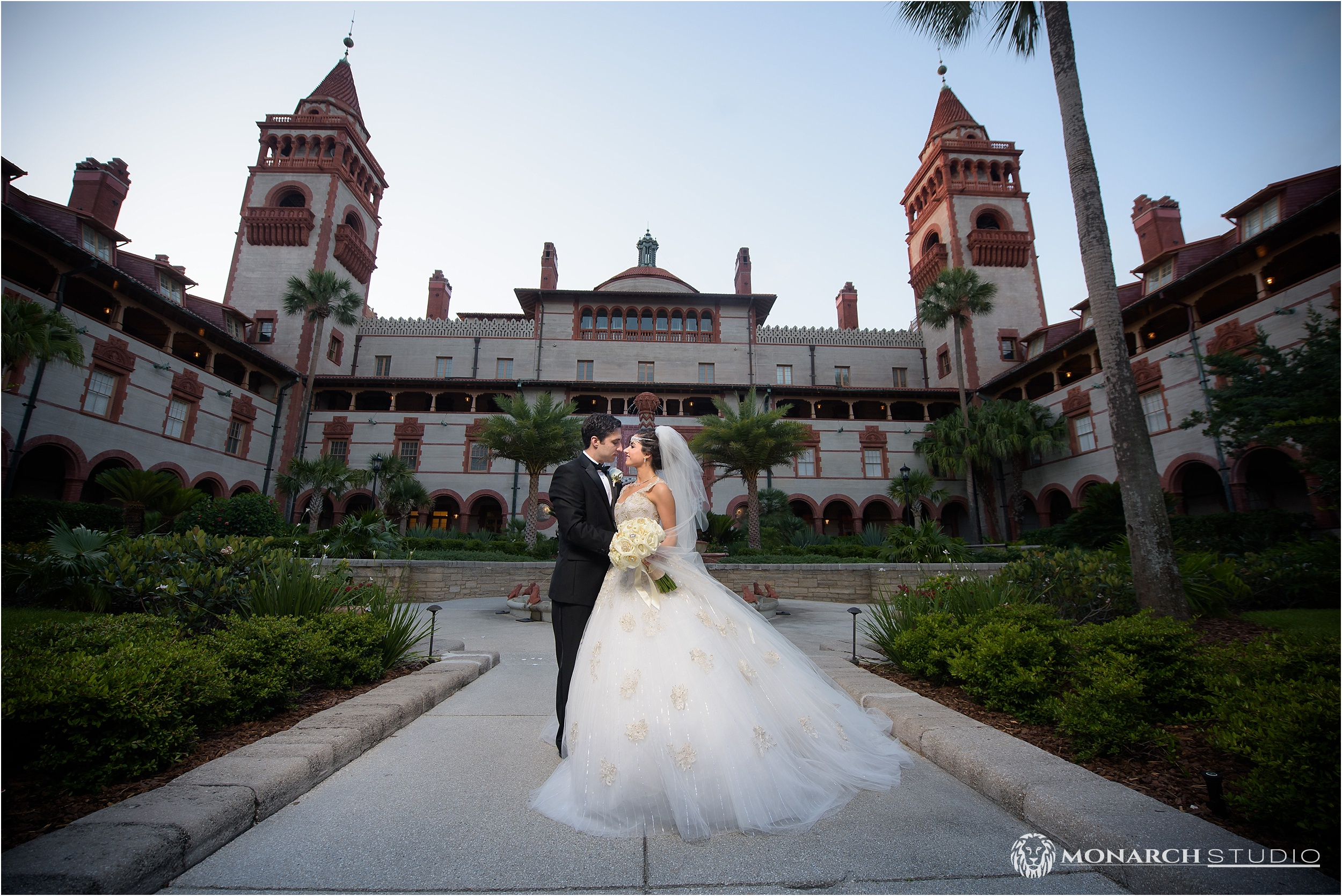 David and Neda stand at the gates  Flagler College with the towers on the background