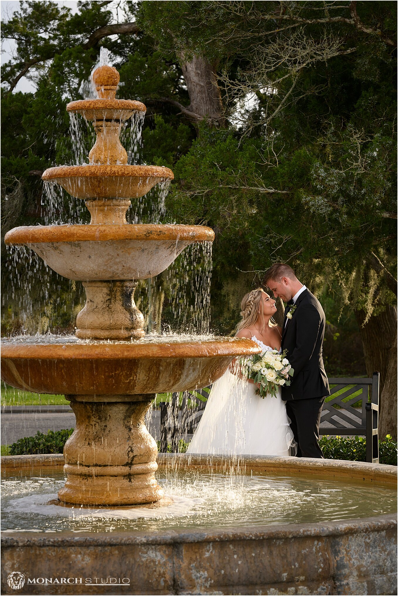 Bailey and Devon at in front of Saint Augustine waterfront wedding venue, the Riverhouse.