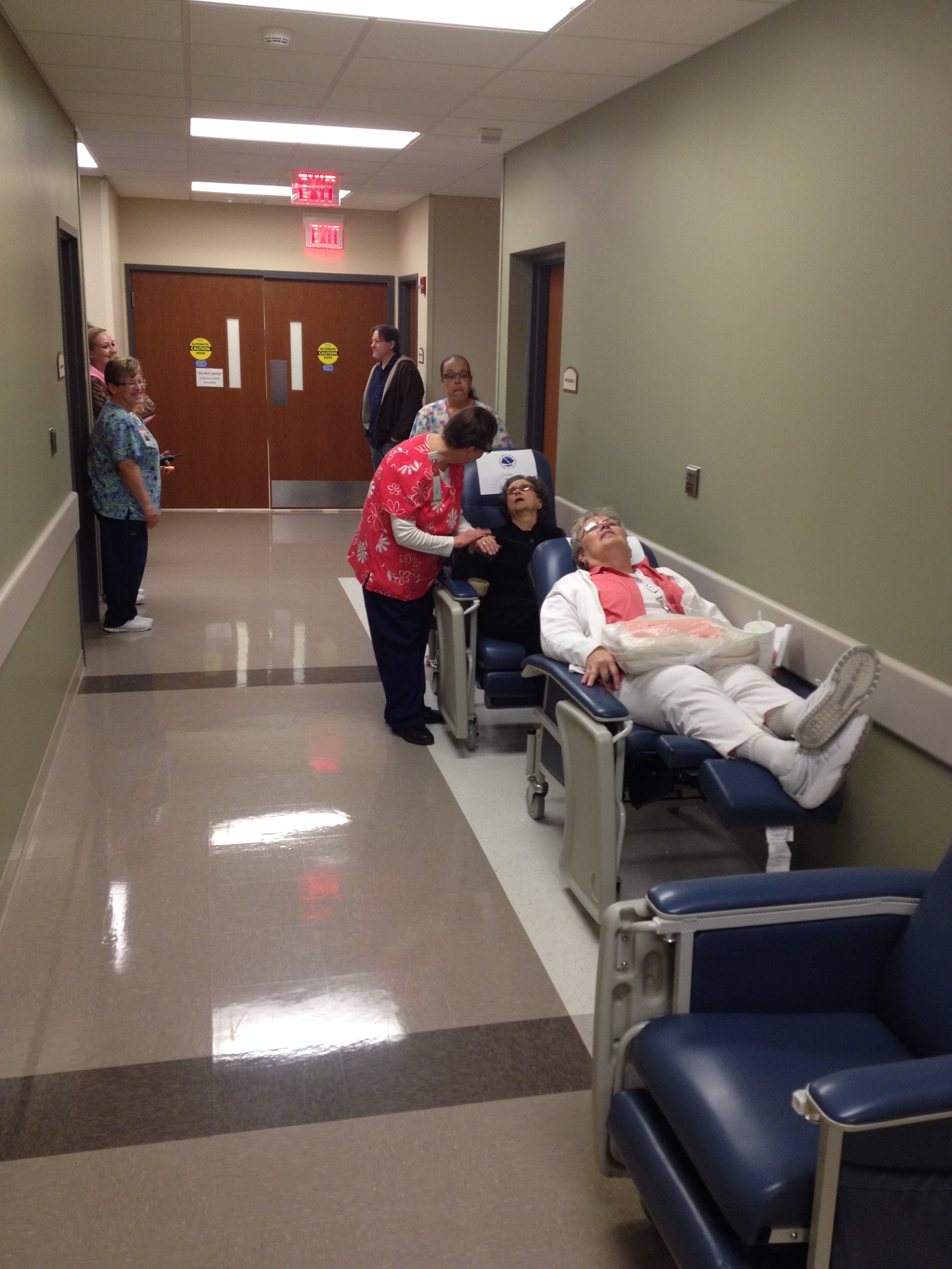 """(Pictured): Susan Bartlett comforts volunteer """"patient"""" Gloria Hull during South Central Kansas Medical Center's tornado drill."""