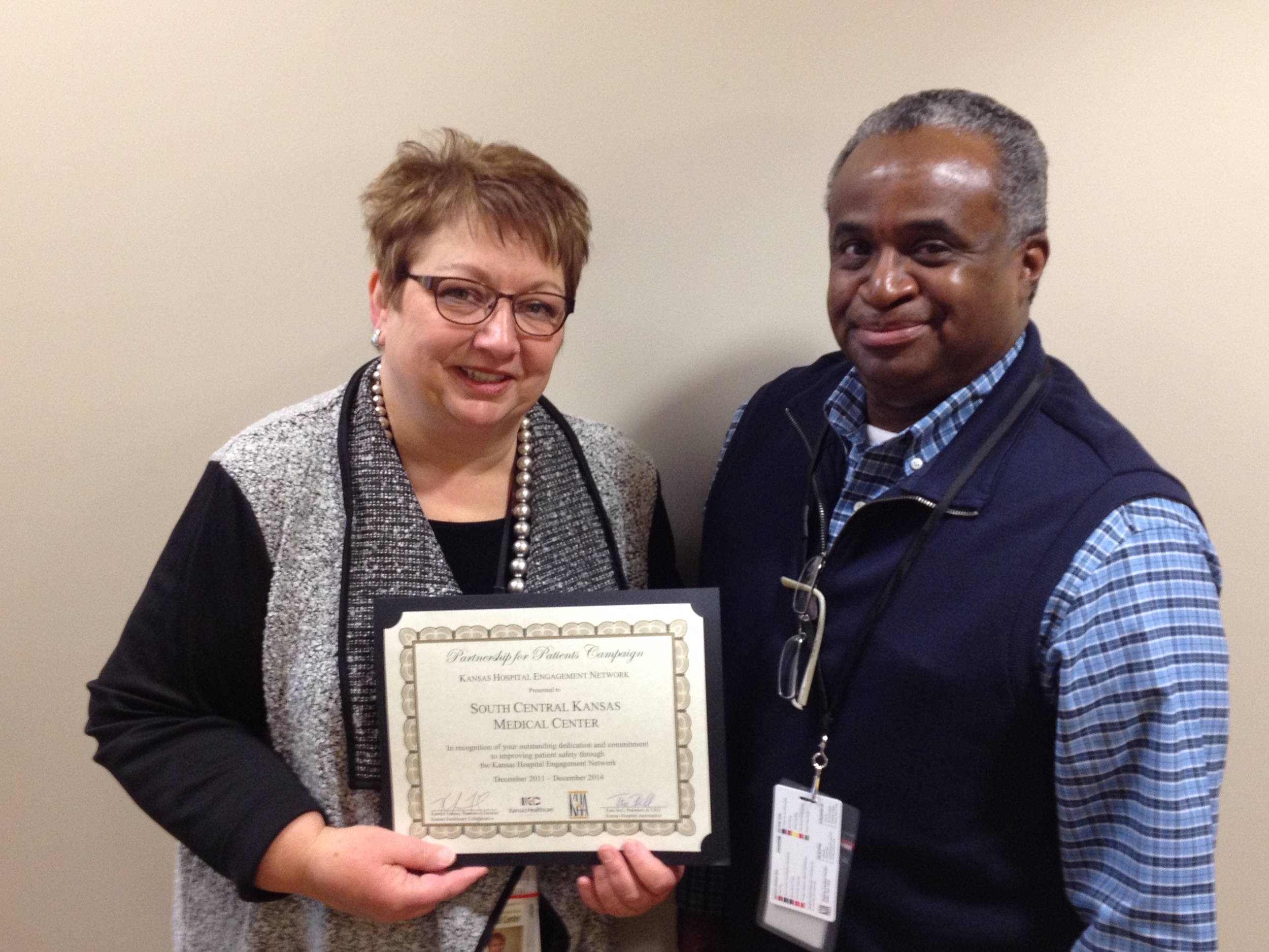 """(Pictured): Virgil Watson, SCKMC's Chief Executive Officer and Jane Campbell, the hospital's Director of Hospital Quality and Risk Management, display the certificate presented by the Kansas Healthcare Collaborative for """"outstanding dedication and commitment to improving patient safety through the Kansas Hospital Engagement Network."""""""