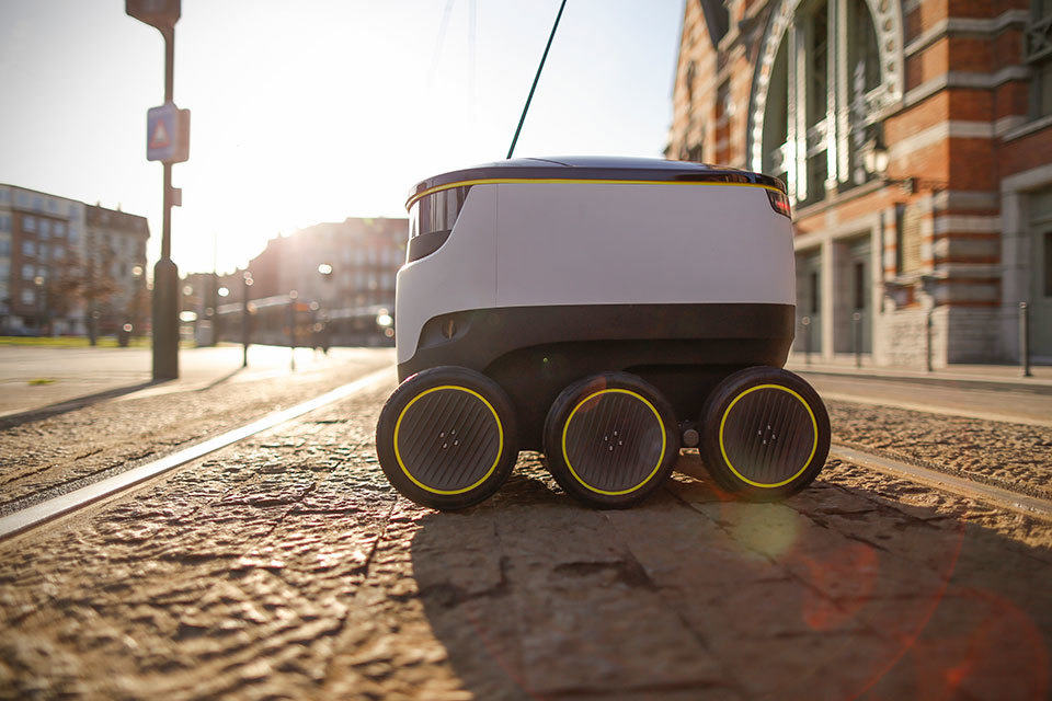 Starship technologies delivery robot. Can hold up to 2 bags of shopping and has a range of 3 miles. Autonomously pilots its way along the sidewalk to deliver to homes.