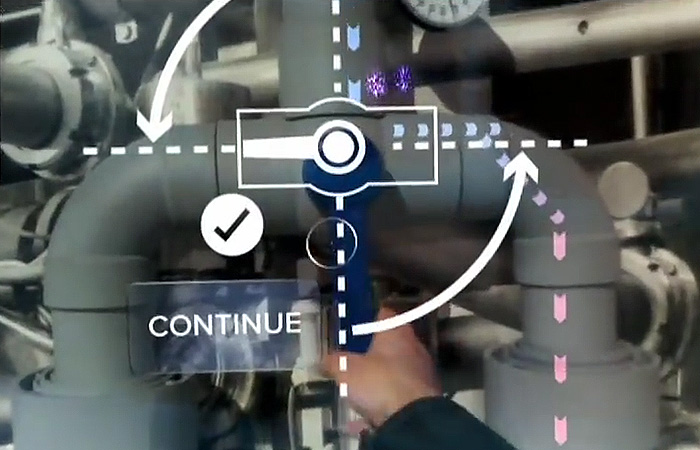 Daqri builds an augmented reality helmet designed for the construction and maintenance sectors. Here a worker is shown instructions on how to operate a valve using augmented reality.