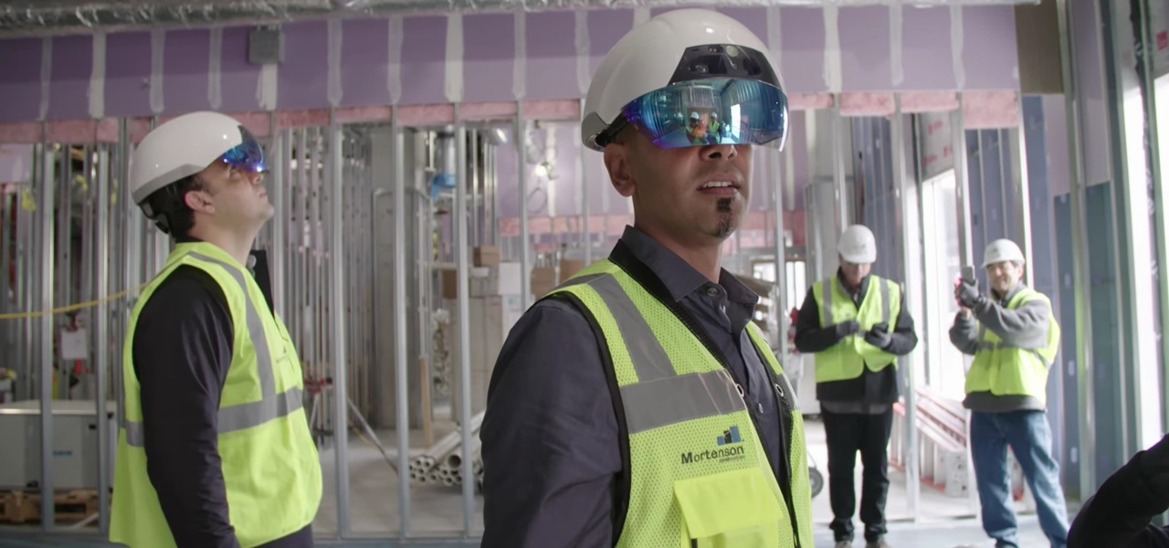 """Construction workers wearing Daqri headsets so that they can """"see"""" where ducting, electrical, plumbing, and other systems are to be located based on architectural plans."""