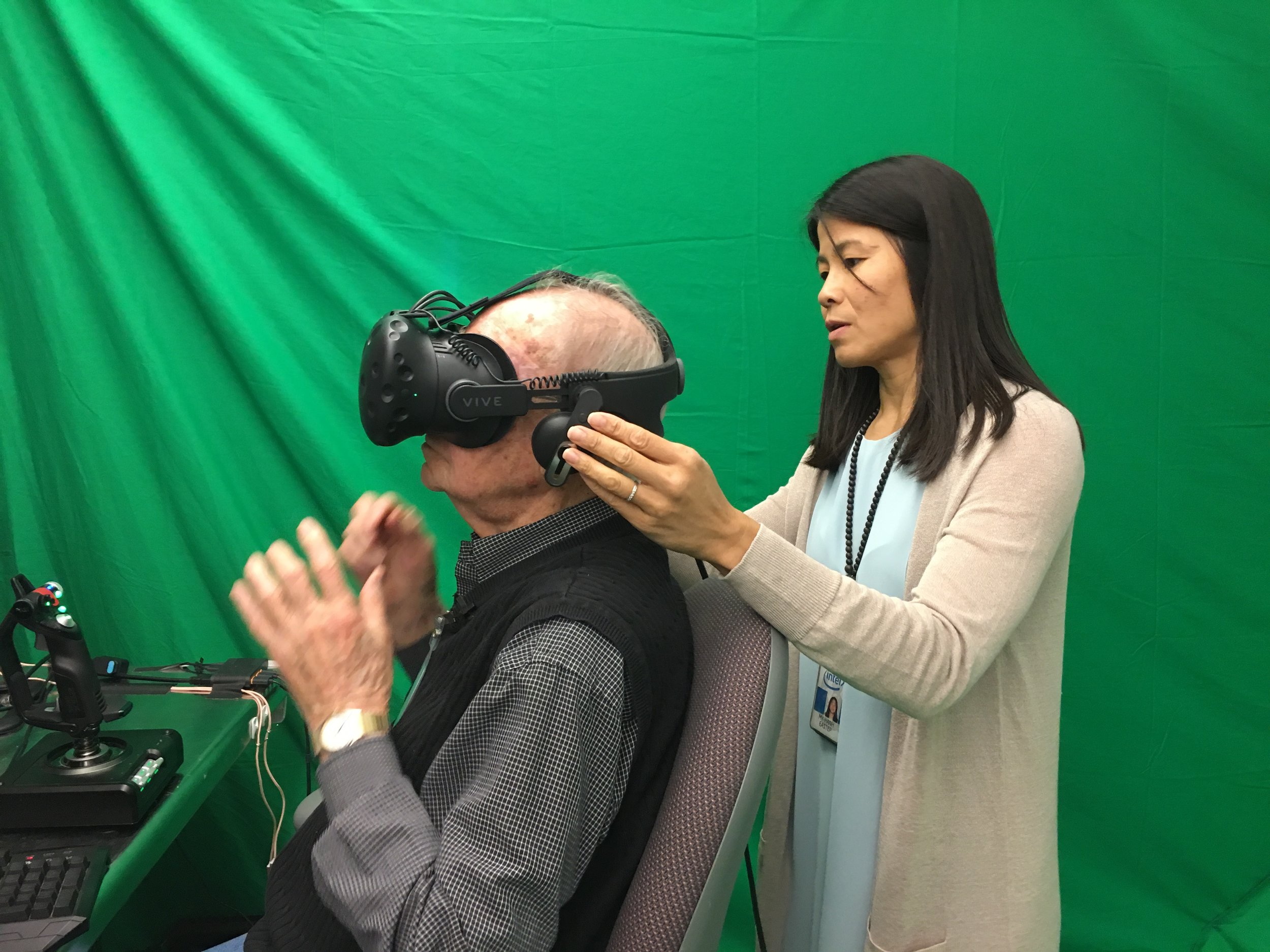 My-Hanh Eastep helps Lyle get ready for his virtual flight.