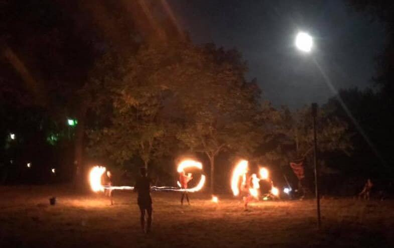 Picture of the night of our first flow fam jam, fire spinning under the full moon!