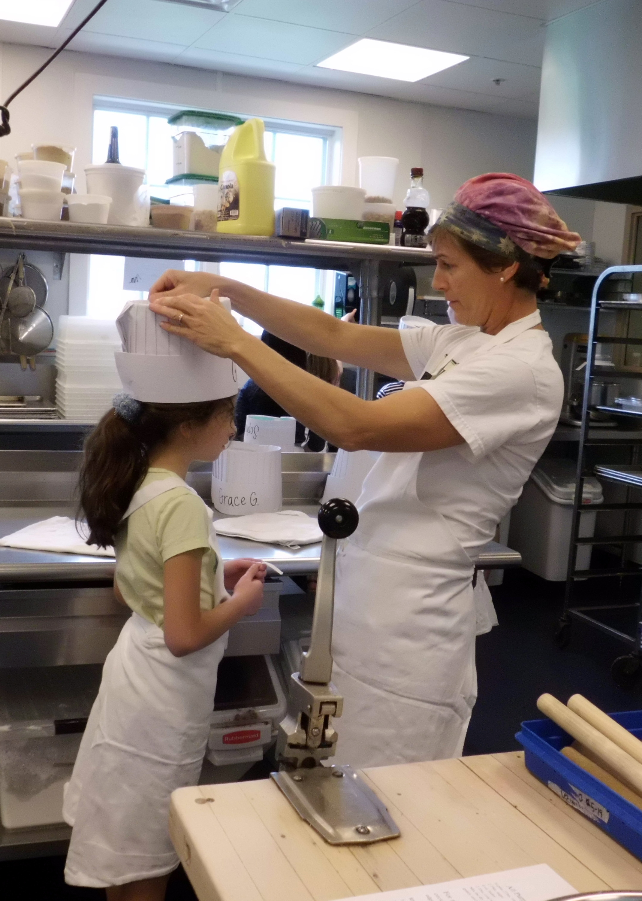 Jennifer VerrillFaddoul prepared a student for the cooking class. Photo by Anne Cushman.