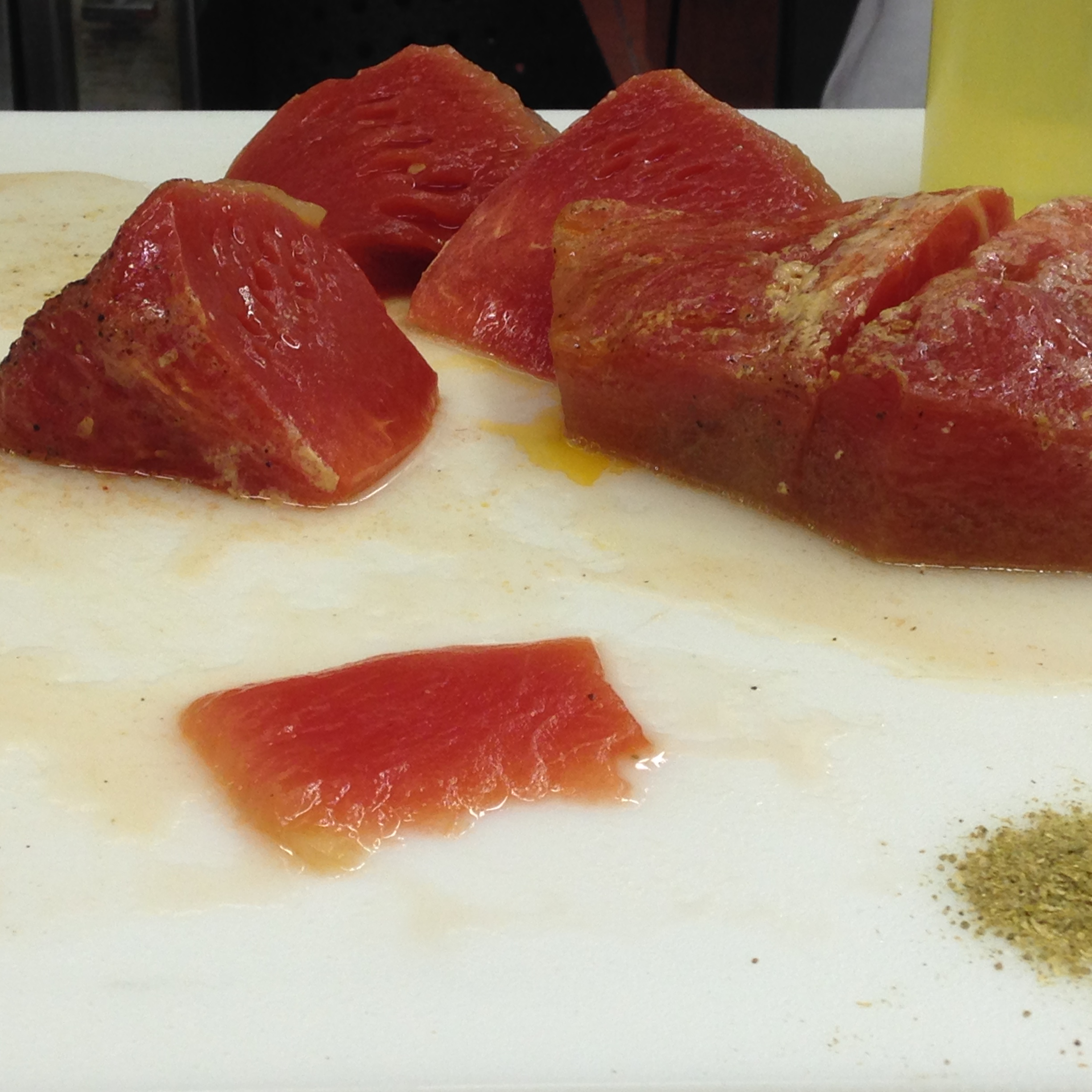 """Portions of the melon are then rubbed with coriander and cumin and seared in a hot pan. The finished """"steaks"""" were served with sheep's milk feta."""