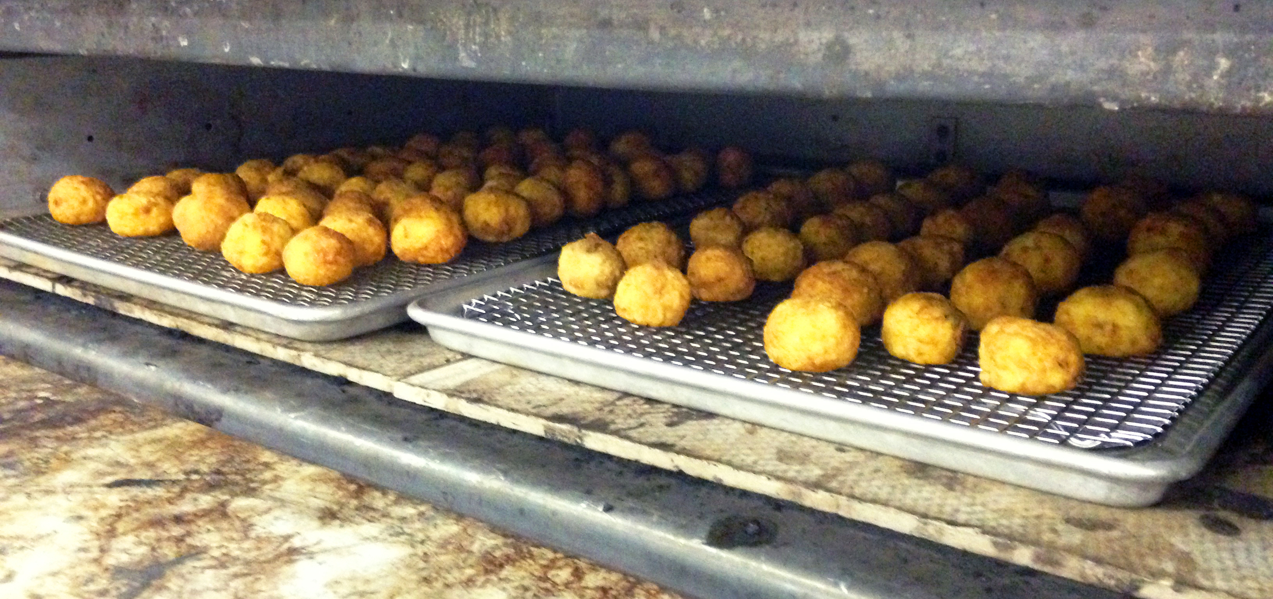 The fried arancini were kept warm in the deck oven before service.