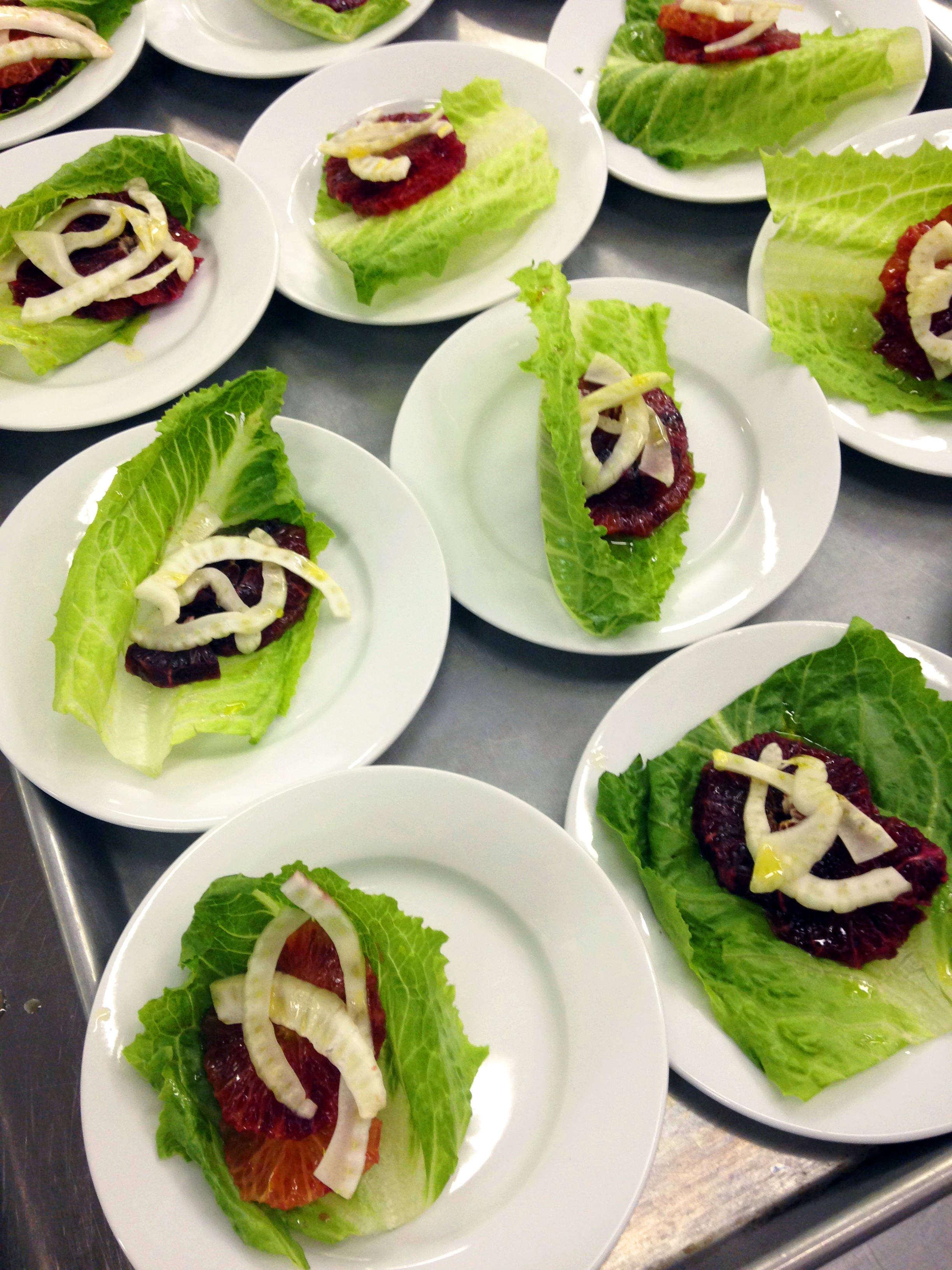 Plated salads before the addition of oil-cured black olives