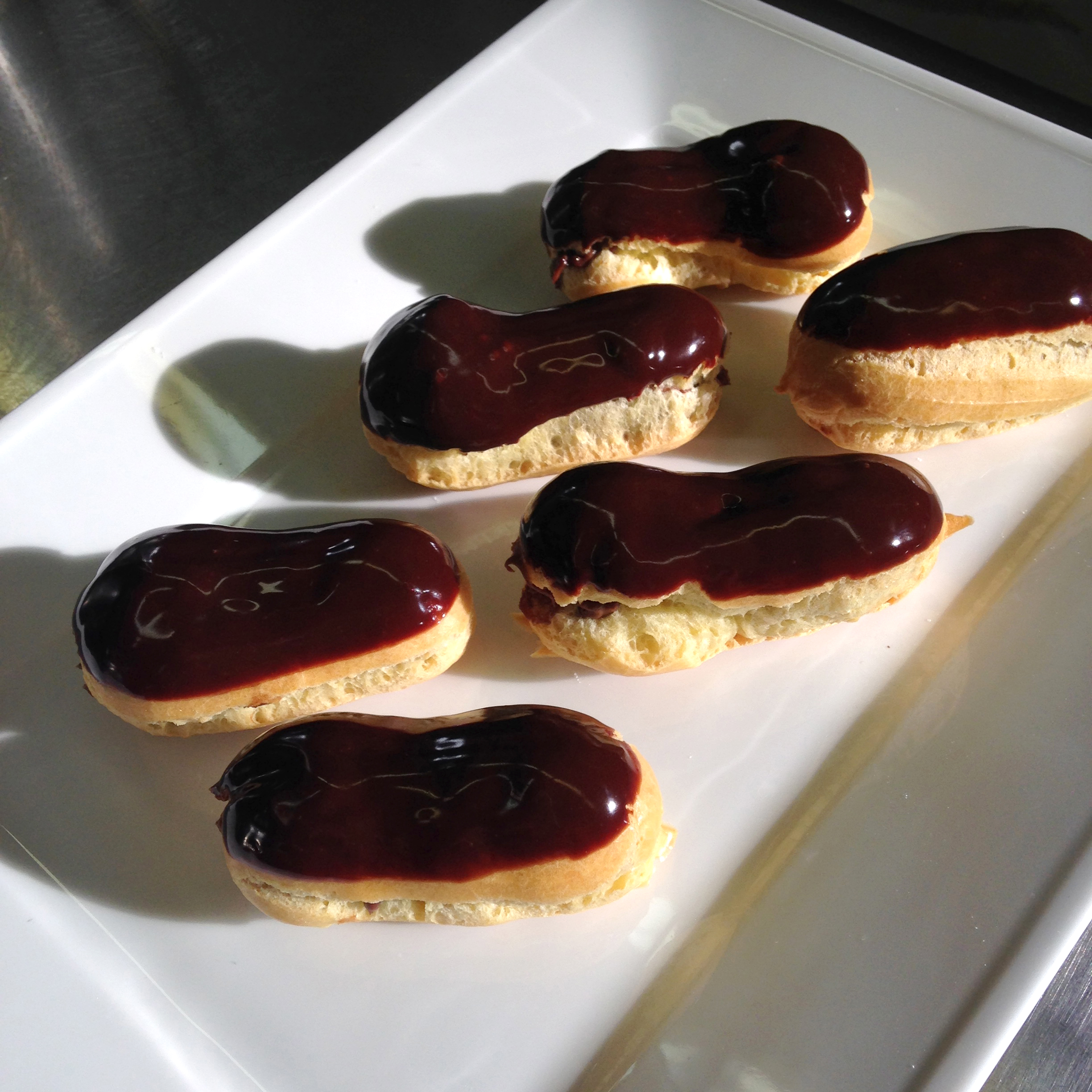 The mini pastries were filled with chocolate cream and dipped in ganache.